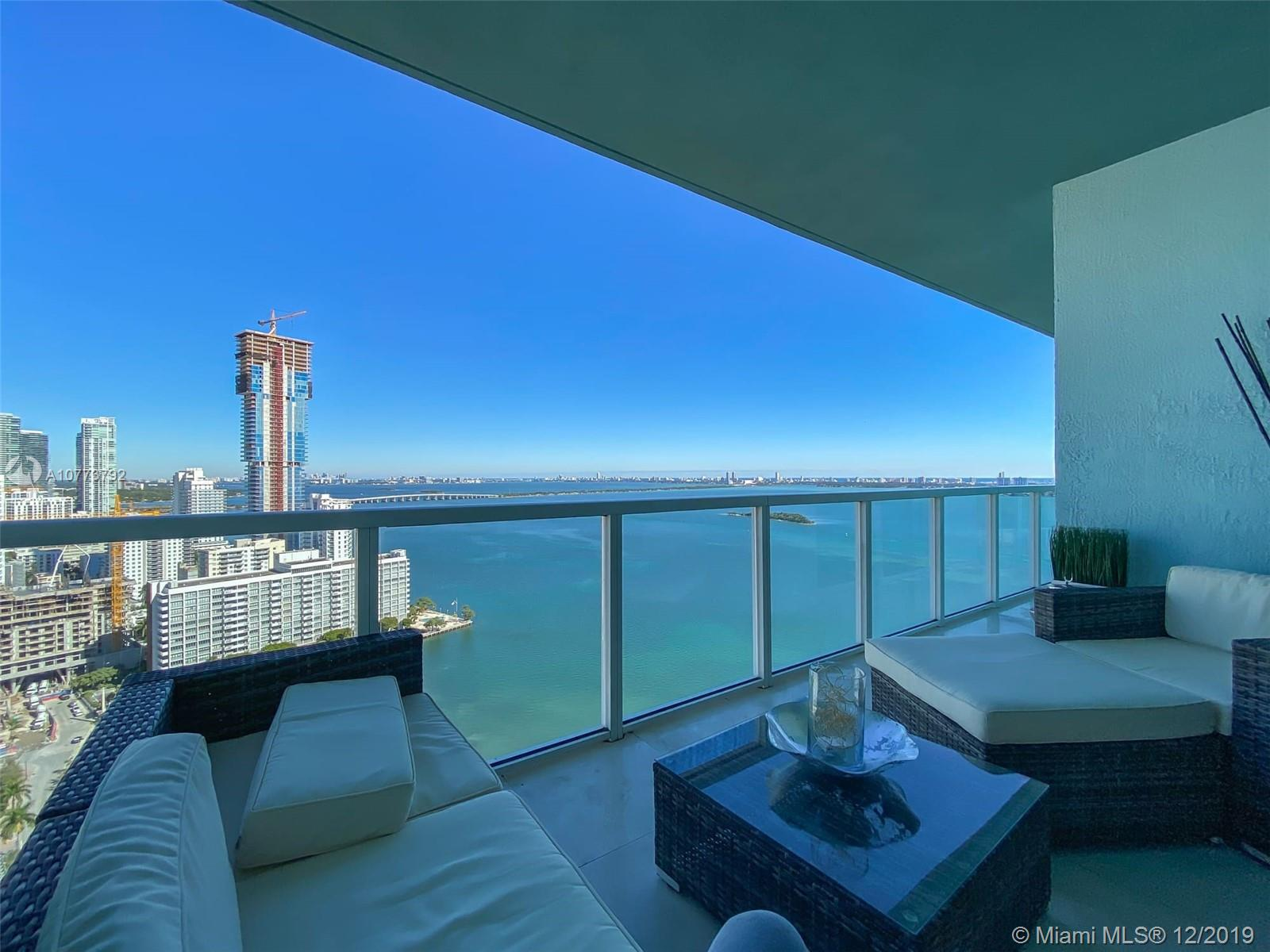 Seller Motivated! Spectacular 2/2.5 +Den with an amazing view of the Bay and surrounding areas. Unit has 24x24 Cream Marfil Marble flooring and stainless steel appliances. Building amenities include 2 pools, 2 story gym, sauna, library, theatre room and much more. Easy commute to South Beach, Midtown, Downtown Miami, Brickell and Airport.