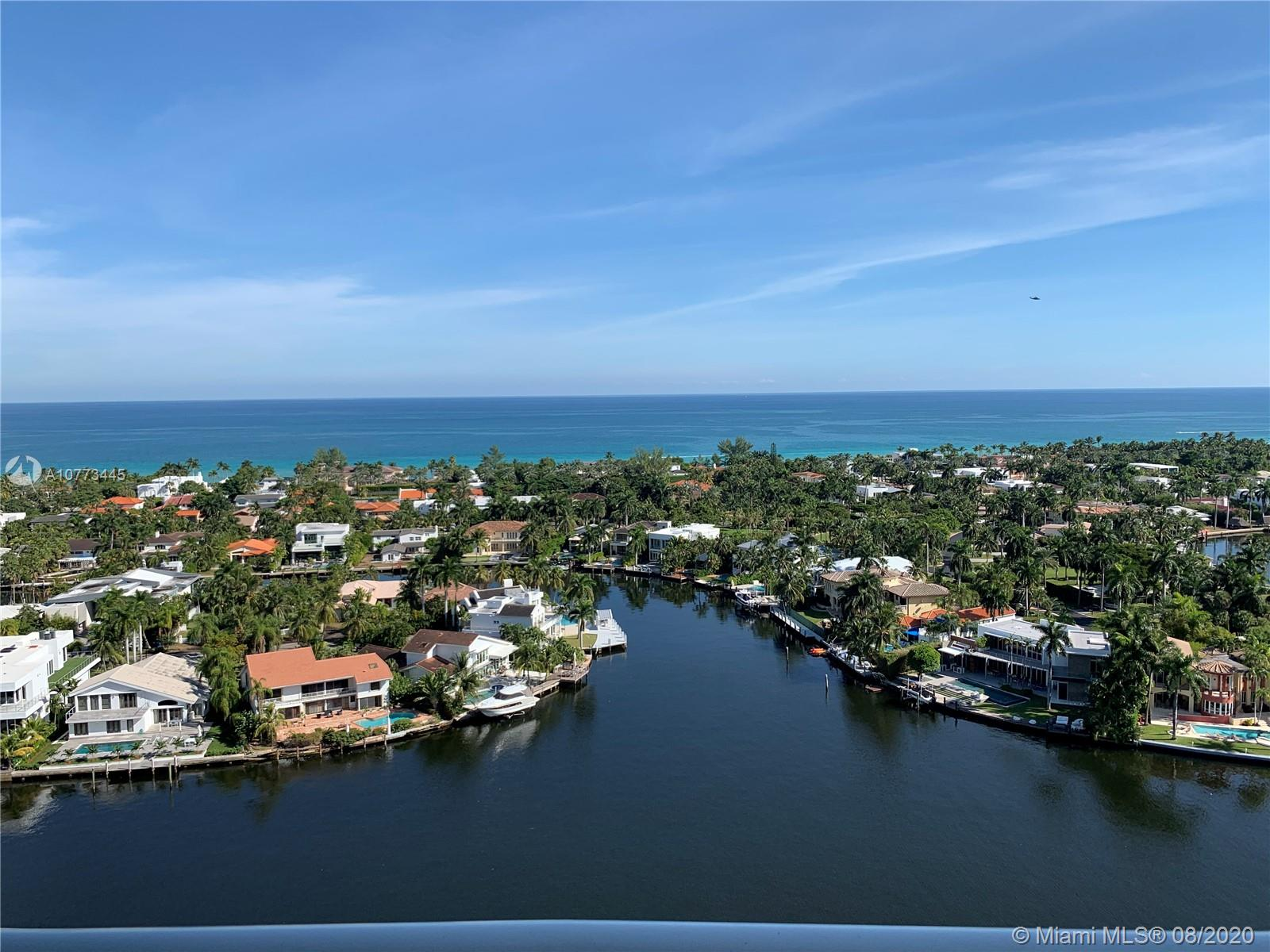 BEST LINE IN THE BUILDING, A HOUSE IN THE SKY, DIRECT VIEWS TO OCEAN, INTRACOASTAL, GOLF AND CITY, UNIT HAS A LOT OF IMPROVEMENTS, ±$50K SMARTHOME SYSTEM, AUTOMATIC BLINDS, ELECTRIC STORM SHUTTERS, TWO NEW AIR CONDITIONING UNITS, NEW WASHER AND MORE. BLDG OFFERS TWO POOLS, RESTAURANTS, MOVIE, SPA, GYM, CHILDREN PLAYGROUND, TENNIS, SECURITY. MUST SEE. EASY TO SHOW.