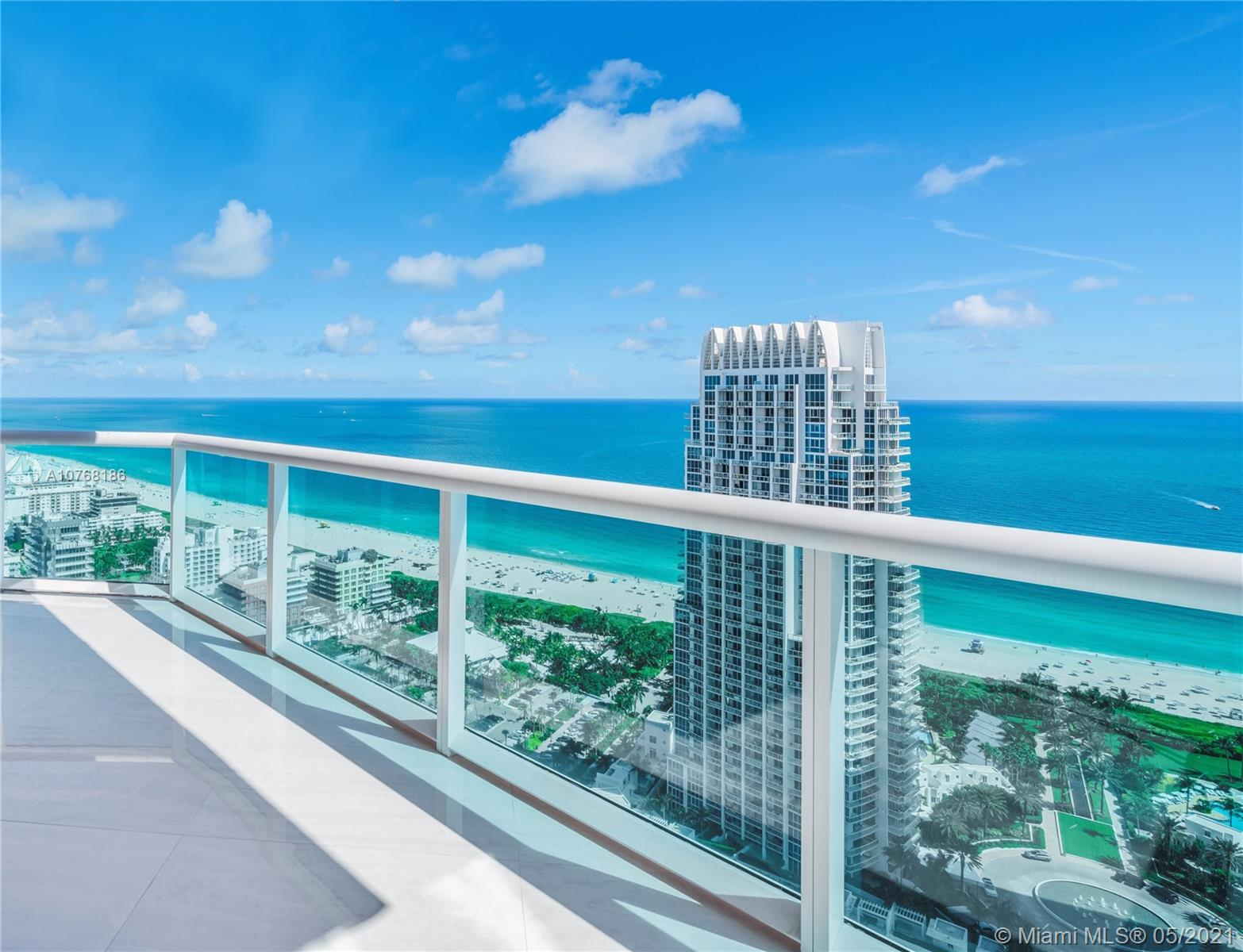 This extraordinary, contemporary-style smart home in the sky is an innovative work of art. This custom designed unit is brand new & fully furnished by iconic Italian luxury brand Visionnaire. Comprised of 2 units meticulously combined to form one impeccable 4,800 sf residence with breathtaking ocean, bay, Miami skyline & sunrise & sunset views. Features include, a flow-through layout, white onyx gloss floors, Vegan stingray leather finishes on the doors & walls, marble bathrooms, Manooi chandeliers, wet bar w/ Rolls Royce style ceiling lighting, Crestron controls & security camera's throughout, gourmet kitchen w/ Miele & Viking appliances & a principal suite fit for royalty with a custom Pink Quartz closet, floating tub overlooking the water, retractable projector & 180 degree views