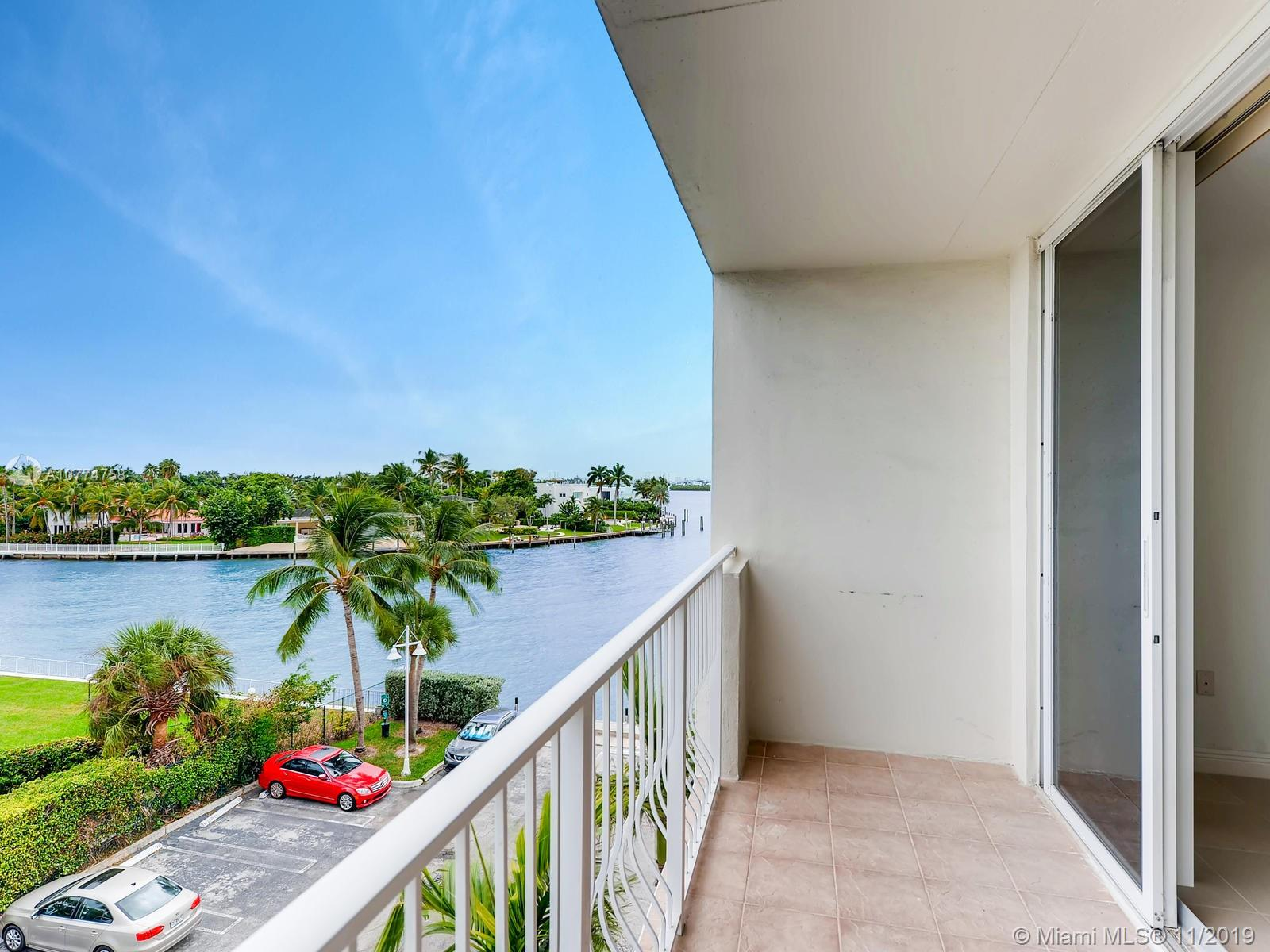 HUGE CORNER UNIT - COMPLETELY REMODELED! EXQUISITE VIEWS WITH PRICELESS SUNSETS OVER THE INTRACOASTAL! THIS UNIT HAS UNDERGONE A TASTEFUL HIGH-END REMODEL INCLUDING IMPACT WINDOWS. 2 VERY LARGE BEDROOMS - SPLIT BEDROOM PLAN. WASHER & DRYER INSIDE UNIT.  2 DEEDED PARKING SPOTS - ONE IS A COVERED SPOT. LARGE AIR CONDITIONED STORAGE ROOM. DOCK SPACE UP TO 30 FEET AVAILABLE FOR LEASE FOR $250 PER MONTH. BUILDING HAS 24HR SECURITY / FABULOUS GYM / PARTY ROOM / BUSINESS CENTER. FABULOUS POOL DIRECTLY ON THE INTRACOSTAL. BBQ AREA. PETS UP TO 50LBS PERMITTED - 2 PETS PERMITTED WITH A TOTAL WEIGHT OF 50LBS. BAY HARBOR ELEMENTARY SCHOOL DISTRICT. BUILDING ITSELF HAS UNDERGONE A MAJOR RENOVATION. LOOKS FABULOUS.  *** OWNER WOULD CONSIDER OWNER FINANCING WITH A SUBSTANTIAL DOWNPAYMENT.