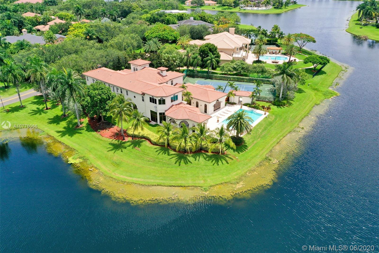 COMING SOON & NEWLY RENOVATED - YOUR DREAM ESTATE awaits you! Enjoy SOUTH FLORIDA LUXURY LIVING at its finest in this breathtaking estate that is perched high on one of the most desirable lakefront lots in Windmill Ranch Estates. This residence boasts 7 Bedrooms, 8 Baths, 2 Half baths together with expansive outdoor living areas, summer kitchen, resort style pool, TENNIS COURT & a 4 car garage. Numerous features include: ALL IMPACT GLASS, elevator, magnificent master suite on first floor, grand formal living areas, fireplace, media room, gym, game rm, amazing children's wing & guest suites, kitchen fit for a chef, butlers pantry, wine cellar & a wet bar. As soon as you experience the feel of this home along with the beautiful breeze from the backyard - you will not want to leave! MUST SEE!