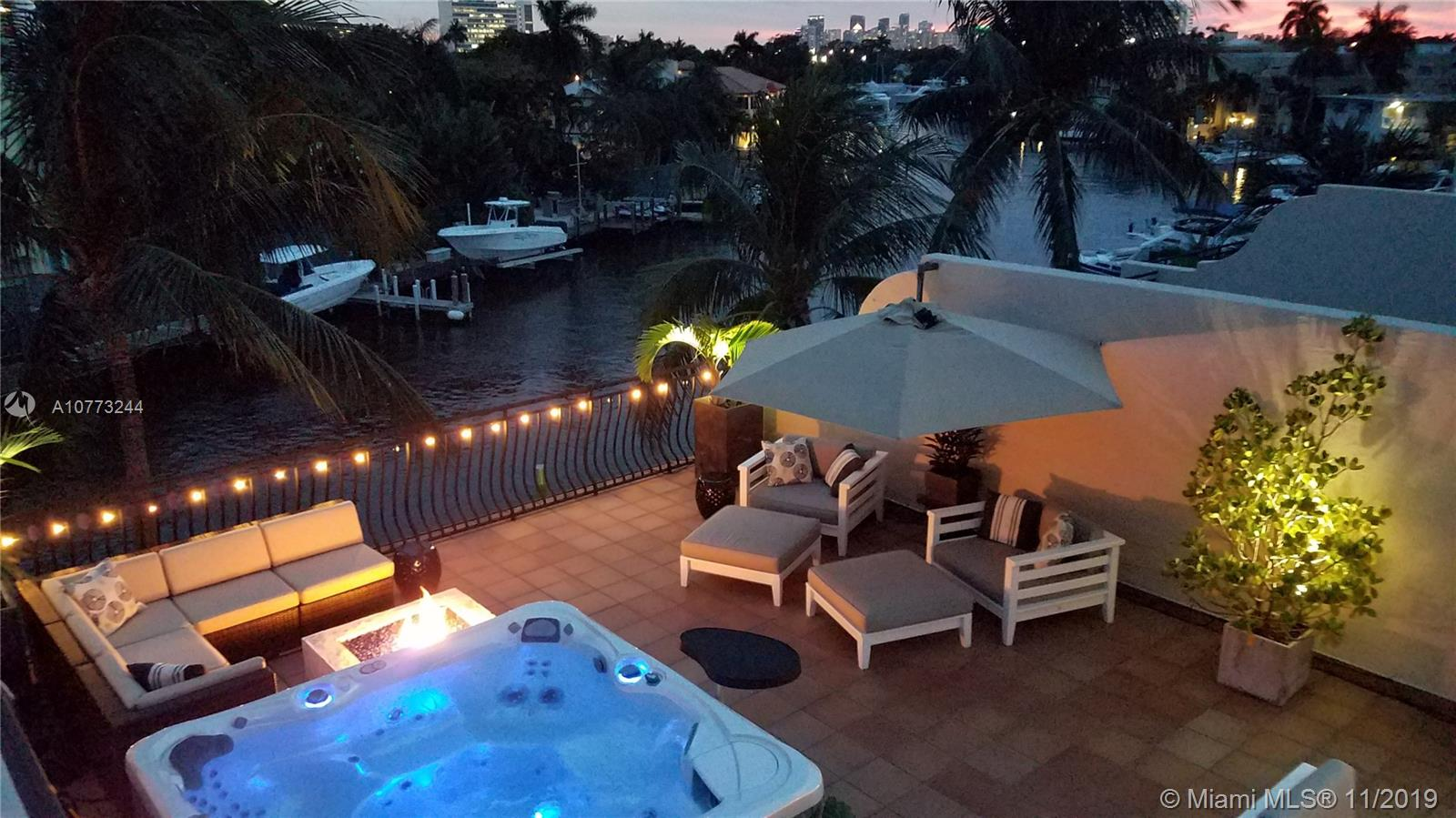 CORAL RIDGE WATERFRONT townhome with assigned boat slip up to 34' ft (50 amp power/water) on deep water canal right off intercostal waterway, no fixed bridges. Beautifully appointed, (3,415 sq ft) 3BD/2BA+2 half baths, master suite/bedroom w/balconies. Marble master bath w/whirlpool tub, separate shower. Impact windows/doors. Spectacular private rooftop terrace w/outdoor kitchen, dishwasher, ice maker & spa completely set up for outdoor living (ALL roof top and main floor outdoor furnishings, spa, tv's, plants, grills as shown are included). Fully furnished option available. 2 car garage. Backup electric generator incl. Whole house/outdoor Sonos/Bose stereo system incl. Smart home features. Custom made 23' foot long one of a kind Shakuff stairwell chandelier.