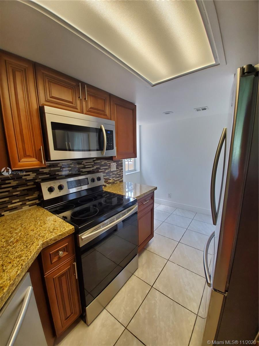 Newly remodeled 2 bed 2 bath first floor corner condo located next to the clubhouse/pool. New kitchen with wood cabinets, granite and new stainless steel appliances. Wood vinyl water proof flooring installed throughout, remodeled bathrooms & showers, washer/dryer in unit, new a/c & new water heater. This condo is turnkey ready to go and boasts views of the lake and pool. No rental restrictions in the community and you can start renting on day one. Easy to show and is a must see.