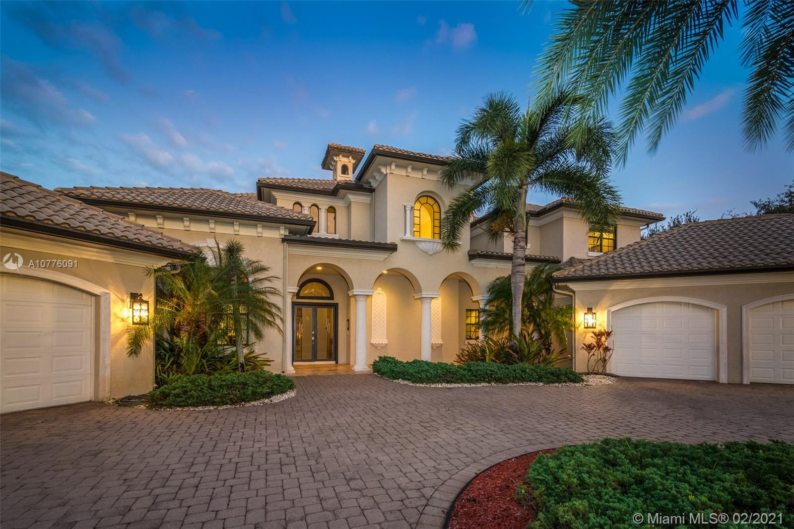 Impressive PRICE REDUCTION. Grand contemporary custom estate home in the heart of Weston in the exclusive gated community of Windmill Reserve. Elegant masterpiece sits on a natural preserve with marble and wood flooring throughout. Master bedroom plus den on first level w/ soaring ceilings and exquisite marble master bath*his/her baths* Jacuzzi* Gourmet kitchen*center island*gas Wolf range*high end subzero refrigerator and appliances. Acre plus fully fenced water lot*resort style travertine pool*fully equipped summer kitchen and entertainment area*heated spa*beach entry* billiard room, home theater, sauna room, bar area and Full impact*Second level with three spacious bedrooms plus two lofts*