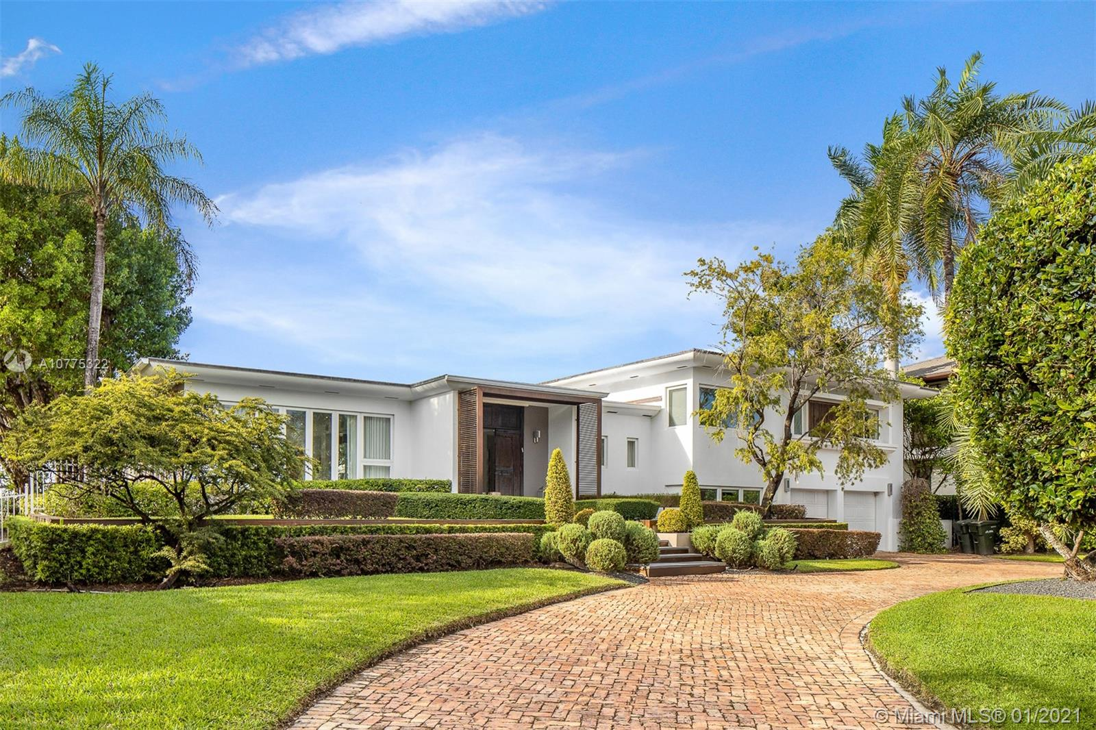 This magnificent MiMo style waterfront home in Bay Harbor enjoys the same views as those of $20mil + homes.  Renovated with curb appeal and dramatic Western exposure. This open, split plan with wood and white glass flooring throughout is perfect for hosting. The master suite is perched right above the water and the dual master bath is spacious and modern. A contemporary eat-in kitchen also faces the prized Western views. Situated on a 20,000SF lot on the premier part of the street with 112 FT on the Biscayne Bay, this is prime real estate. Outdoor entertaining is special with a sunken summer kitchen, lush landscaping throughout, and an oversized pool to enjoy all year round. Live minutes from Bal Harbour Shops and surrounded top schools. This can be your dream come true on the water!