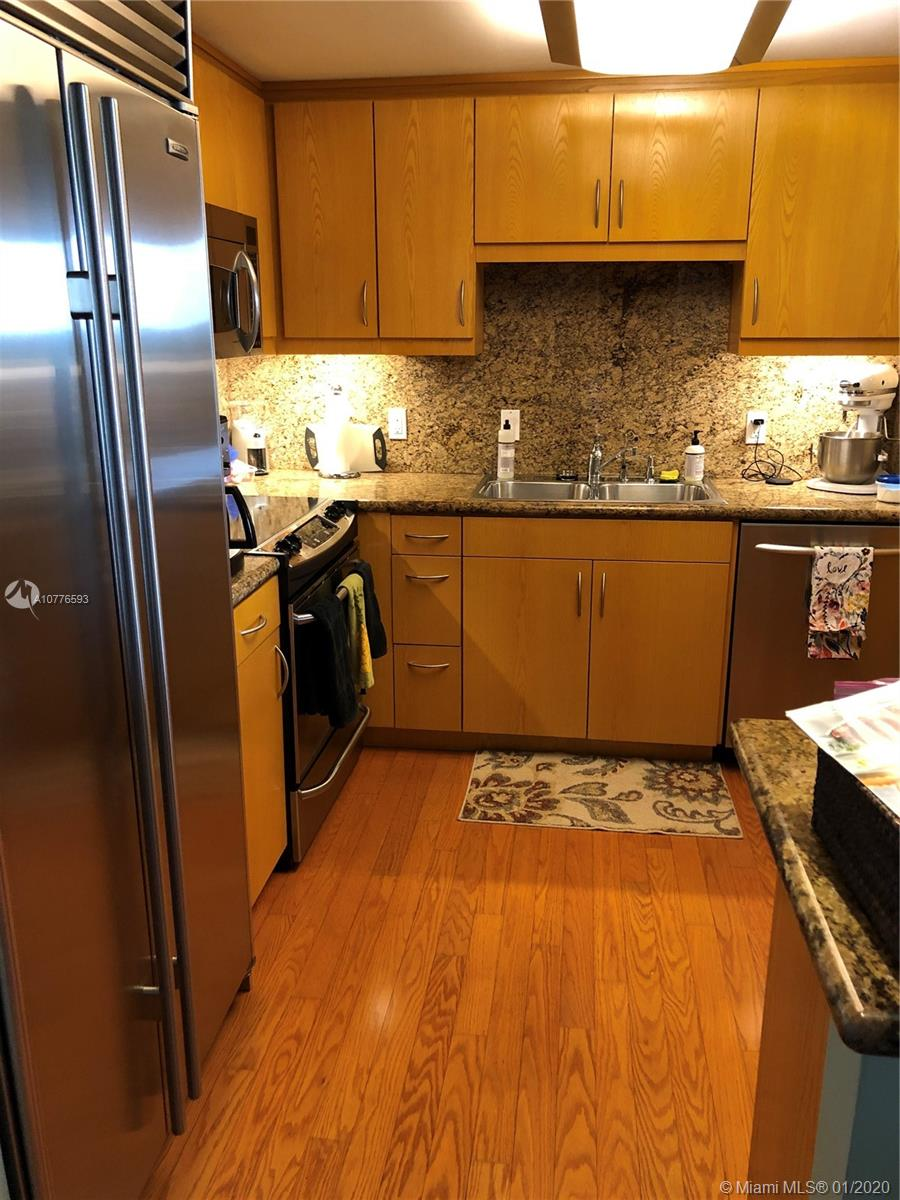 Beautifully updated 2b/2B  condo in the heart of Coral Gables. Very spacious unit with open floor plan. SPECTACULAR VIEW TO THE SOUTH OF THE CITY. The unit is featuring a renovated kitchen with appliances, new A/C and lots of storage, lovely floors throughout the unit, updated bathrooms, and shutters. Washer and dryer inside unit, as well as a common laundry room and additional storage. One assigned parking space and ample guest parking. Building offers 24 hour security, doorman, concierge desk, billiard room, library, large community room with catering kitchen for special events, gym exercise equipment & large deck adjacent to the over-sized swimming pool. Conveniently located in very close proximity all the shops, restaurants and night life of Miracle Mile.