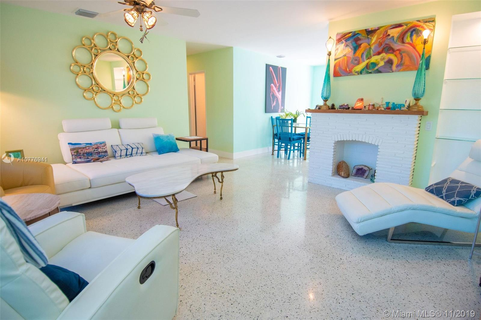 Move in ready, recently renovated home in East Wilton Manors. You are warmly welcomed into the open and inviting living space by the beautiful polished terrazzo floor and enhancing color scheme. The light kitchen has lots of meal preparation space on the natural Alexandrite counter tops. Open the French doors off of the dining area to enjoy Southeast Florida's tropical weather by swimming in the South facing large pool or relaxing in the expansive backyard encompassed by a wood privacy fence.  Updates include a new electric panel, dedicated 50 amp power for RV, new plumbing pipes inside and under the home out to the street, a/c and hot water heater 2 yrs young. Protected by accordion shutters and impact front door. Come fall in love with this home!