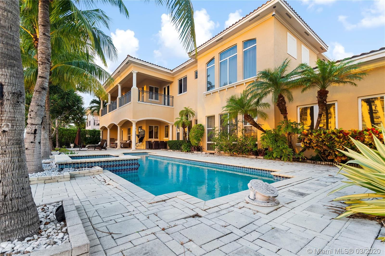"""Located 30 minutes from North Miami Beach, come discover a private Island neighborhood in Hollywood Beach. The very attractive and well manicured """"Three Islands"""" has direct water access and is located in close proximity to the beaches and the best shopping center in South Florida.This wonderful property built in 2004 offers you 5,800 sq. ft. 6 bedrooms, 7 baths with a 3 car garage on a large double lot. 110-ft dock & 20-ton boat lift offers intercoastal access with no fixed bridges requiring maintenance. Enjoy your private swimming pool, 2 Jacuzzis and your private spa that includes a regular and wet sauna. Enjoy this magnificent family home, feel enamored thanks to the detail-oriented landscaping. Filled to the brim with stunning modernupgrades.Dream home that won't last long!"""