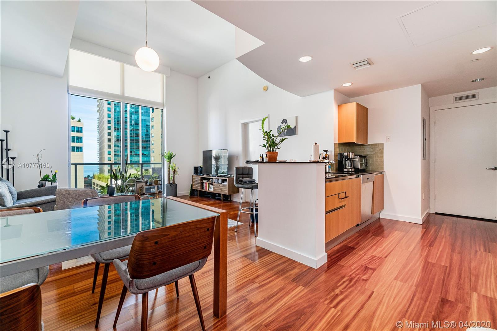 Welcome to 1060 Brickell, one of the most sought after buildings in the heart of Brickell. This One bedroom unit has lot of light thanks to East orientation with water views from the moment you open the door. Also has a bigger feel thanks to its oversize height ceilings as floor 12th has a higher height that other floors as it is the amenities level. Impact windows, hardwood floors, kitchen and bath updated 3 years ago 15-16' ceilings. half bath is not available on this line. Pool, gym, yoga room, virtual golf to name a few of the amenities on this same level. Unit is in pristine condition!