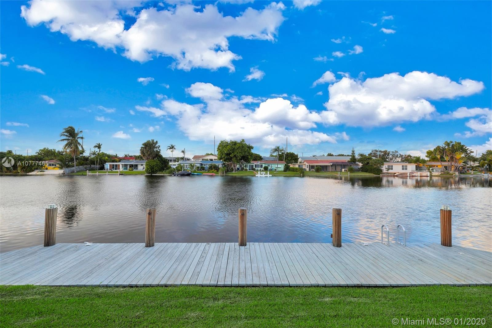 Pride of ownership shows on this immaculate 4 bedroom waterfront home located on the exclusive Jenada Isle of Wilton Manors. Surrounded by 200' wide middle river canal. This home is a must see, beautifully remodeled and views of the water from nearly every window in the home, with large bedrooms, remodeled kitchen that sits in the center of the home with a view of the water and tons of natural light..Impact windows and doors, 2 year old AC, NEW 50' dock and a backyard with sunsets to die for.. Lighted patio, sailboat style pillars and outdoor speakers . Set up an appointment to see today!