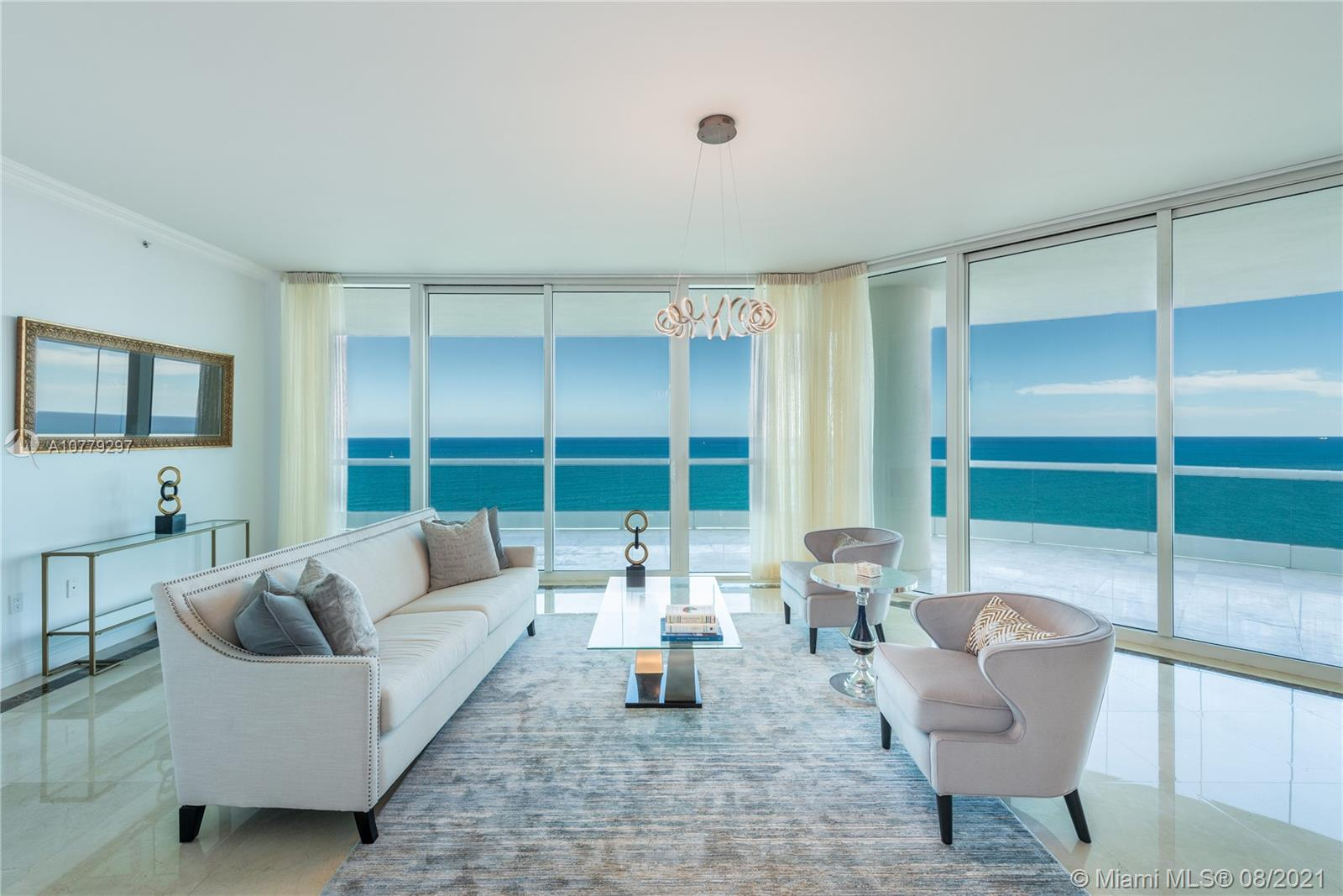 Experience South Florida's oceanfront living at Turnberry Ocean Colony in Sunny Isles Beach – a lavish residential enclave situated on approx. 650 feet of pristine beaches. Residence 2104 is a luxury corner unit with 10-foot ceilings & East/South/West exposure offering panoramic ocean & intracoastal views. Private elevator & entry foyer are leading to the expansive living areas which are enclosed with an oversized wrap-around terrace with a BBQ. Direct oceanfront chef's kitchen with a top-of-the-line appliances & breakfast area, oceanfront master suite with 2 marble baths & massive walk-in closet, 2 guest bedrooms with en-suite baths with intracoastal views, & a fourth bedroom with ocean views. Five-star amenities, 2 restaurants, nearby world-famous Bal Harbour Shops & Aventura mall.
