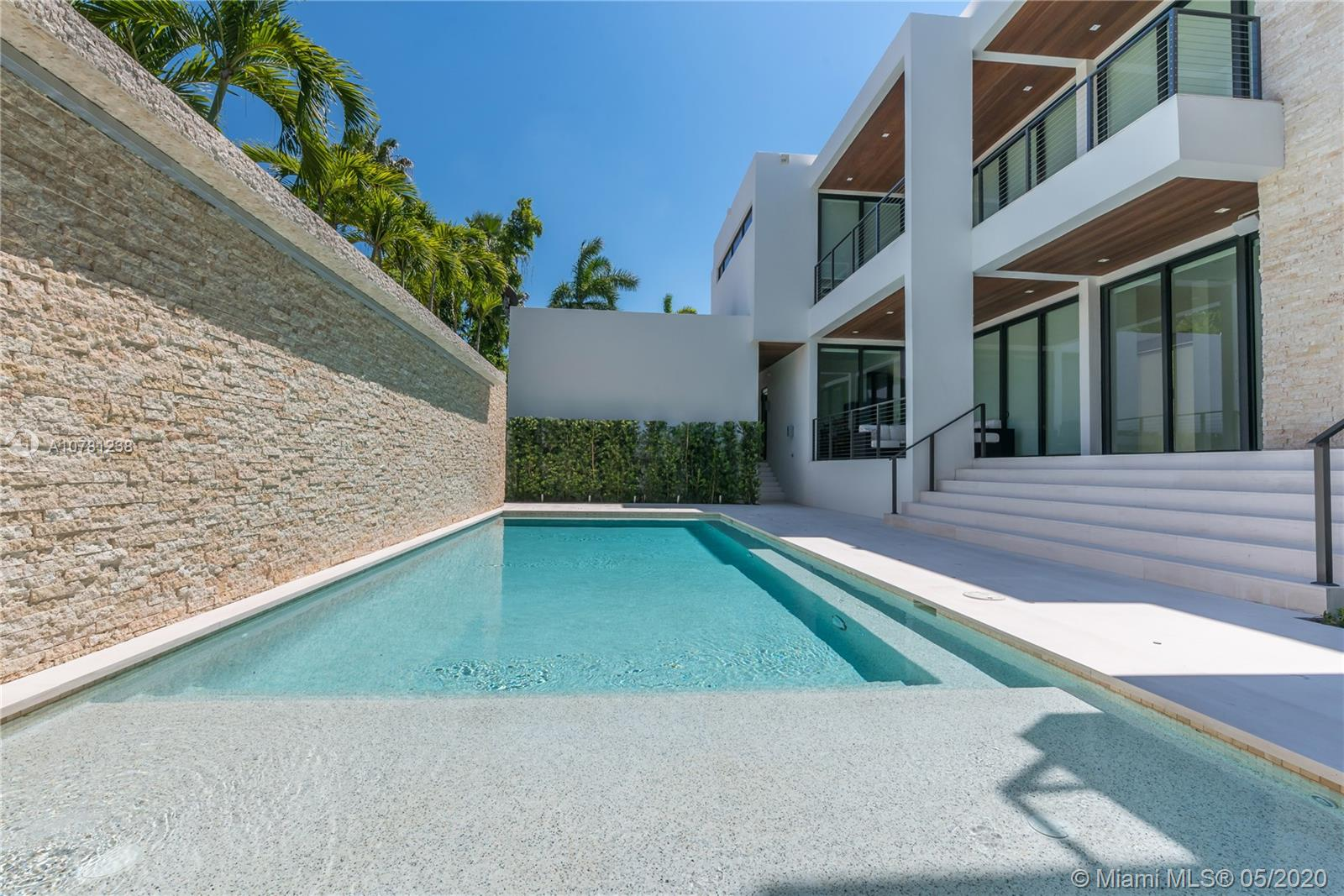 """New Construction on the most desirable street in Miami Beach, Rivo Alto Drive. This """"statement property"""" is a 5 bedroom, 5 ½ bathroom residence with over 5,000 adjusted interior sq feet. This smart home features Lutron window treatments, an outdoor Jacuzzi, heated pool with a waterfall feature and an outdoor summer kitchen. On the 3rd Floor, a very rare 1000+ sq foot roof deck with Panoramic Bay views. Also features a 2 car garage."""