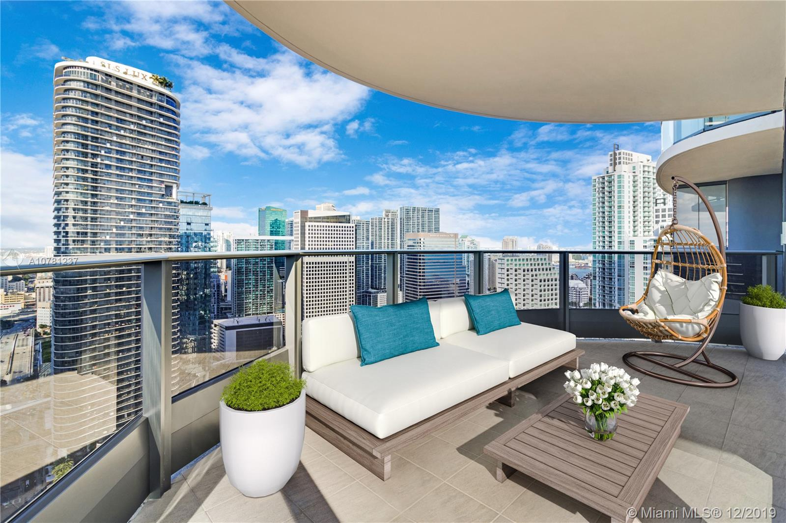 NYC skyline meets Miami's with most anticipated Flat Iron Brickell. The coveted corner 12 line residence, the only reconfigured floor plan unit, sold out, offers unobstructed sweeping vistas from the 40th floor featuring 1,446 SF, 2 wraparound terraces, a grand master suite, Snaidero kitchen, Miele appliances, upgraded Italian acrylic doors, beautifully crafted marble bathrooms, upgraded Italian porcelain floors for a sleek sexy Miami style! The masterpiece by Ugo Colombo and designed by Luis Revuelta offers luxury like no other with 64th rooftop pool, spa, and gym above the city, an additional 18th floor pool, movie theater, and billiards lounge are some of the key amenities to enjoy as an exclusive resident. Be one of the few to call Flat Iron home! Sellers financing available.