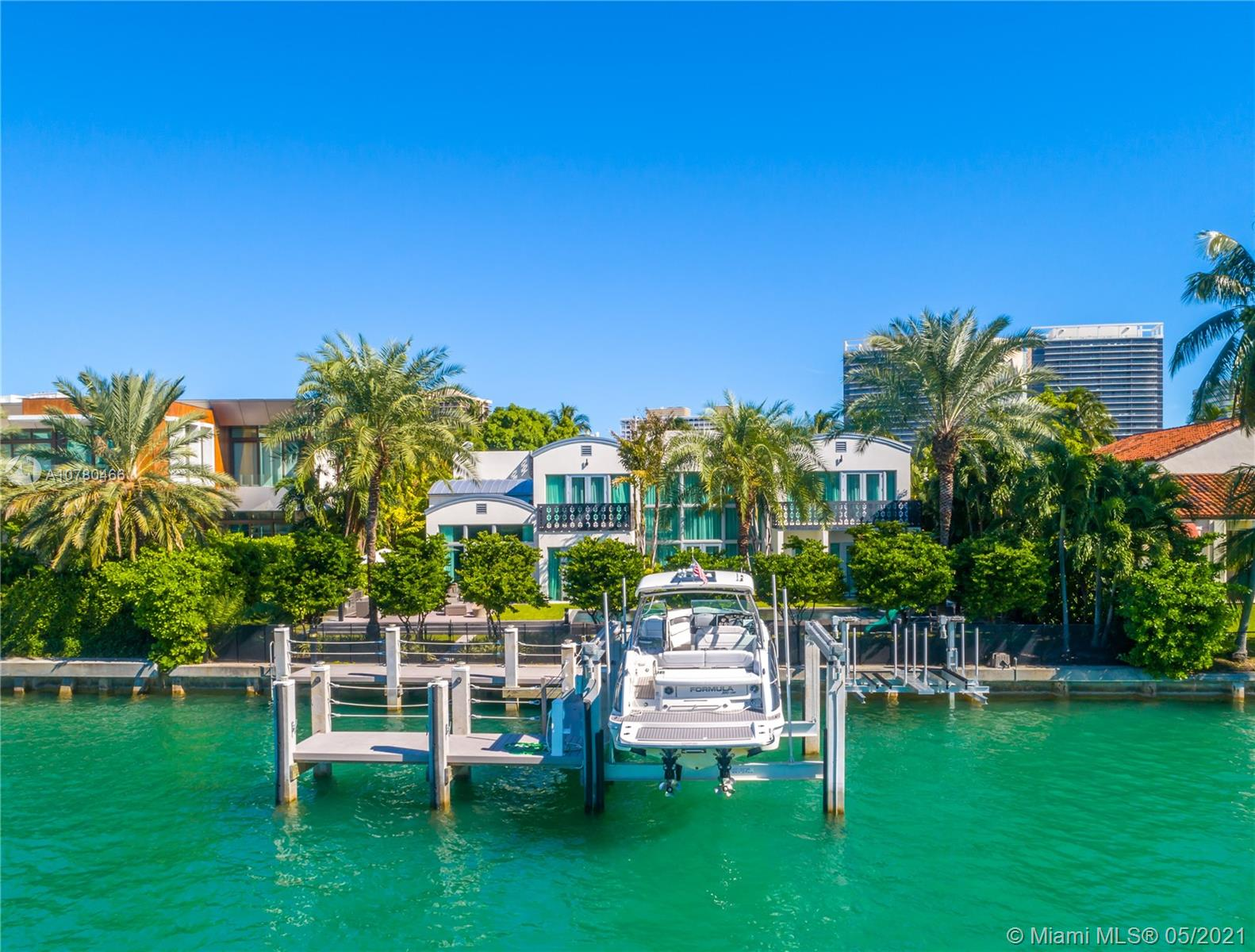 """Unique contemporary waterfront home located in at the prestigious Bal Harbour Village with only 31 Homes.The nine-bedroom, 10.5-bathroom mansion inside the  upscale gated community.Situated on 21,225 square feet, the home boasts 100 feet of water frontage w/boat lift & dock.This stunning home is furnished & appointed w/the finest amenities. Built w/solid concrete & impact glass thru-out. Also features a """"Smart system,"""" 3 car garage, rooftop observation deck, infinity pool, triple staircases, high ceilings, gourmet kitchen w/double appliances,outdoor terraces off every room w/sweeping water views. Architecturally distinctive on exclusive 24 hrs PRIVATE gated community. Easy Ocean access with no fixed bridges. Real Sellers."""