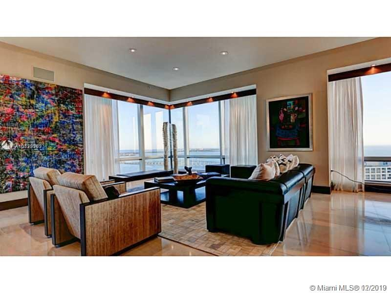 Largest F line over 4,000 SF ! The exquisite corner unit in the world-class Four Seasons Residences offers spectacular views of the Bay and Miami skyline. This unit offers an incredible, open layout with a spacious living and dining room, a gourmet eat-in kitchen with high-end appliances 
