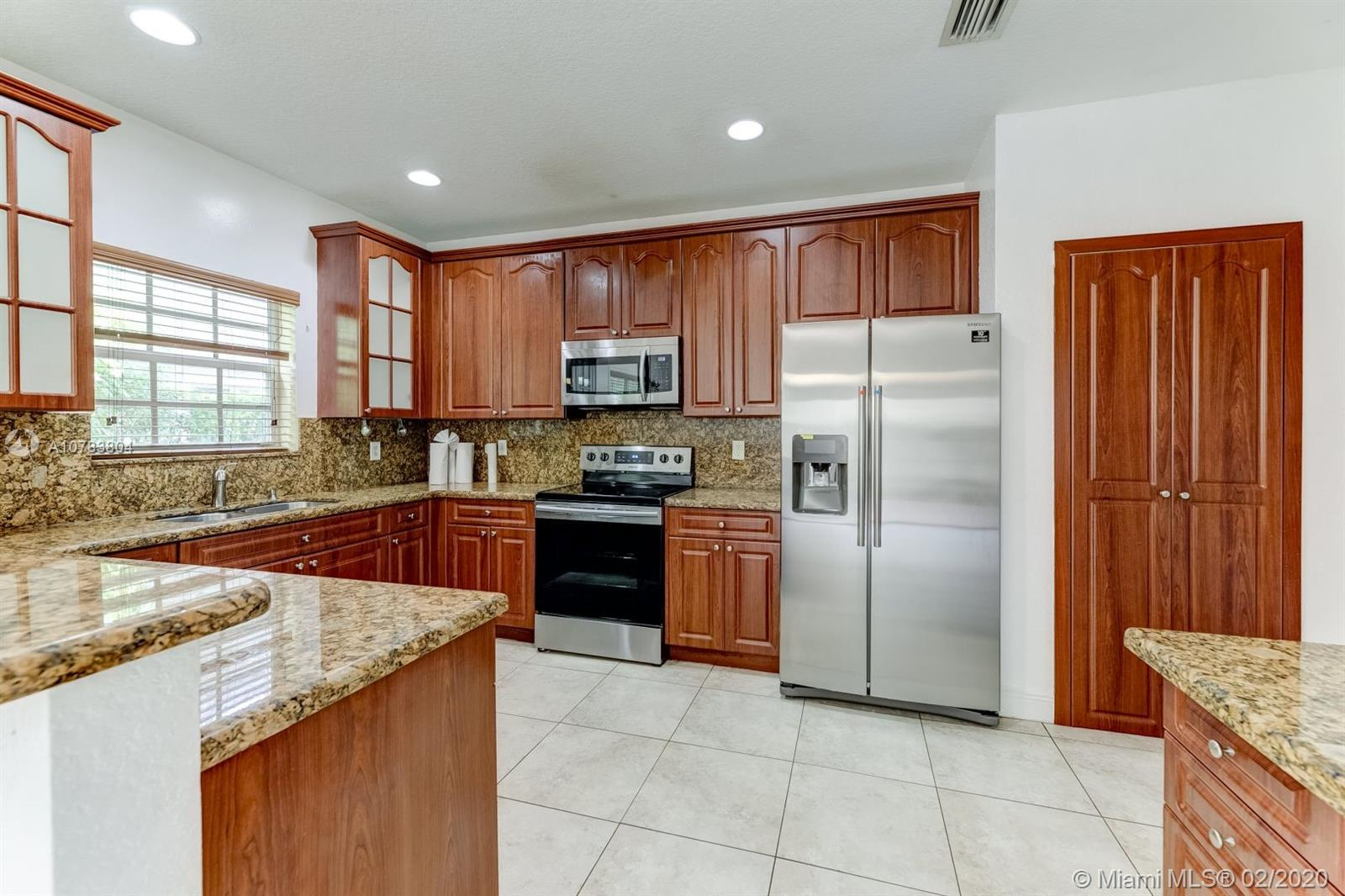 WOW!!! JUST REDUCED -- Beautiful gated community,  fully renovated 2 story 3 bedroom and 3 full bathrooms, 2 car garage home and with high ceilings throughout including the garage located in Vizcaya . One bedroom/one bath on the first floor. Two master bedrooms upstairs. Inviting kitchen with Granite counter tops,  new stainless steal appliances, pantry, plus a bonus desk. New Washer and Dryer on the 2nd floor. New A/C installed. Spacious layout with many windows offering natural light. New wood flooring in all bedrooms . HOA fee includes club house, lawn care, community pool, tennis court, basketball court, playground, and gym. Close to all major shopping centers and highways.  No HOA approval needed. A must see! Schedule you appointment now.