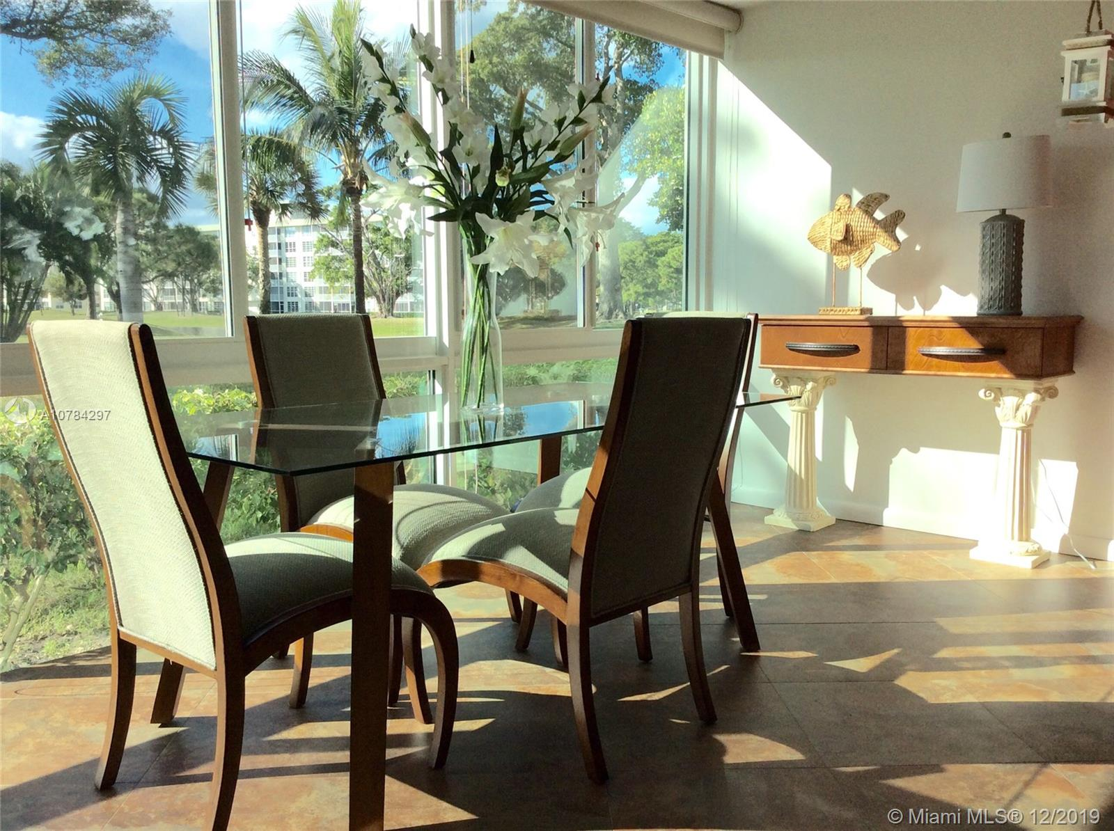 Spectacular, immaculate 3/2.5 2100 square feet corner unit, with no expense spared. This Property features lake view, trees and hills. Huge master bathroom with seperate vanities. Master bedroom has sitting area with floor to ceiling windows. No carpet. Granite countertops in kitchen, stainless steel appliances, high impact windows, remodeled bathrooms. Just steps to the pool. Association requires 20% down.