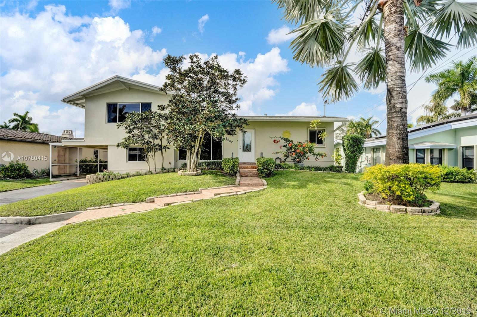 Wonderful highly sought after Tri-level home sits 5 lots off point with 65ft of deep water with ocean access and no fixed bridges. This 3/2 features lots of natural light with vaulted ceilings, recently updated kitchen w/Corian counters and SS appliances. The eat-in kitchen opens out to the back yard to make for easy entertaining. Updates in the last year totaling $60k include a completely new 45ft dock with new dock pedestal providing 50 amp/30 amp power and water, updates to seawall including weep holes, new 400 amp electrical panel, all cast iron waste/sewer lines and water supply line replaced, and new HVAC unit. These upgrades are HUGE in the long run.  Lauderdale Isles is centrally located with easy access to all major highways and minutes to downtown, tri-rail, airport, and beaches.