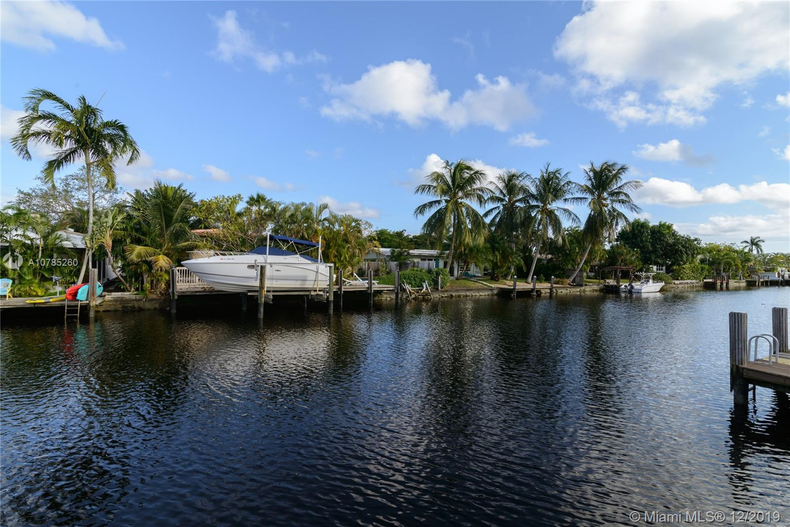 """Waterfront Home with Ocean Access. Great location in the Heart of Wilton Manors. Boat Lift and 30' dock set on an 80' wide canal. Priced under market value- this home is a great buy for the right buyer looking for an ocean access home at an amazing price. Open concept with a great room perfect for entertaining with scenic water views. Large Kitchen with 42"""" cabinets and granite counter tops and stainless steel appliances. Tastefully remodeled with tile floors and a newer roof and hot water heater. Circular driveway and a 2 car carport allows parking for more then 6 cars. Perfect location- Beach, shopping, restaurants are less then 10 minutes away. This is a great price for a great home! Don't miss out!  SEE REQUIRED ATTACHMENTS"""