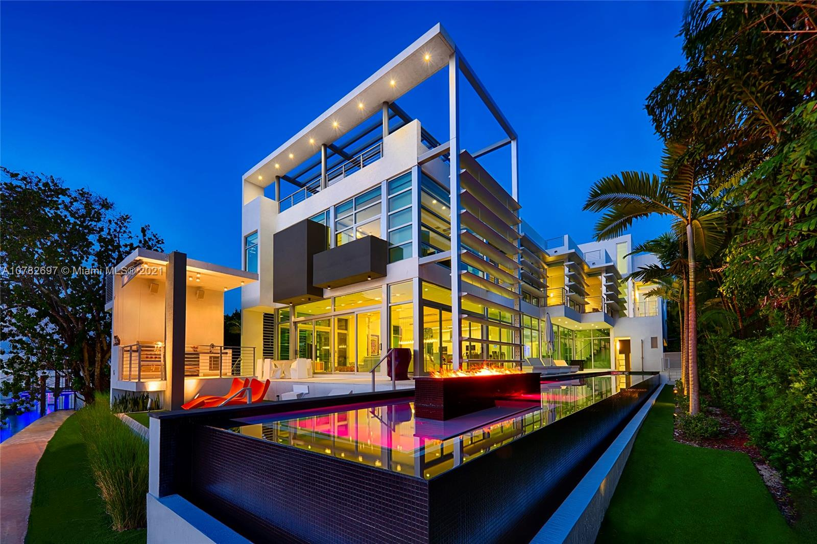 This sleek ultra-modern tri-level waterfront masterpiece sits on the coveted tip of guard gated Hibiscus Island. Impeccably designed with no expenses spared the residence features exquisite porcelain & oak wood floors, masterfully designed open living, dining & family areas all feature breathtaking unobstructed views to Biscayne Bay & the downtown Miami skyline. The home sports a gourmet kitchen w/top-of-line appliances, spacious state-of-the-art movie theater, fully equipped bayside gym, & second story principal suite that overlooks Biscayne Bay. Outdoor features include an infinity edge lap pool, Jacuzzi w/fire pit feature, expansive rooftop lounge w/360 degree views to bay & city, dock/boat lift. +/-85 ft of water frontage. As per owner, property has 6,607 SF of living area.