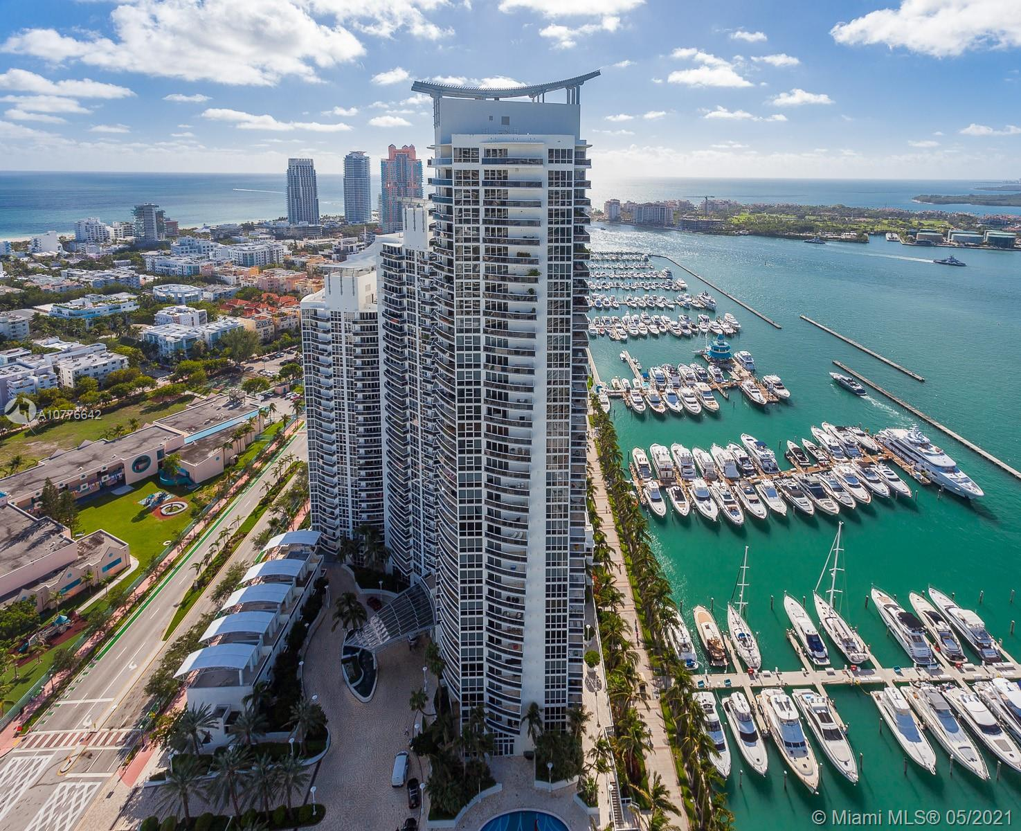 Stunning view of all of Miami and the beach from this home in the sky; lower penthouse of the largest floor plan at the Murano Grande in the Sofi (South of Fifth) district. Originally 4 bedroom, now converted to 3 Bedrooms + Den + maid's quarters. Formal living and dining with amazing bay/skyline and Fisher Island views. Large kitchen with family room and dining/breakfast area with vast ocean and city views. Full service condominium with on site restaurant on the pool deck and resort like amenities. Rented until June 2022 @ $18k per month