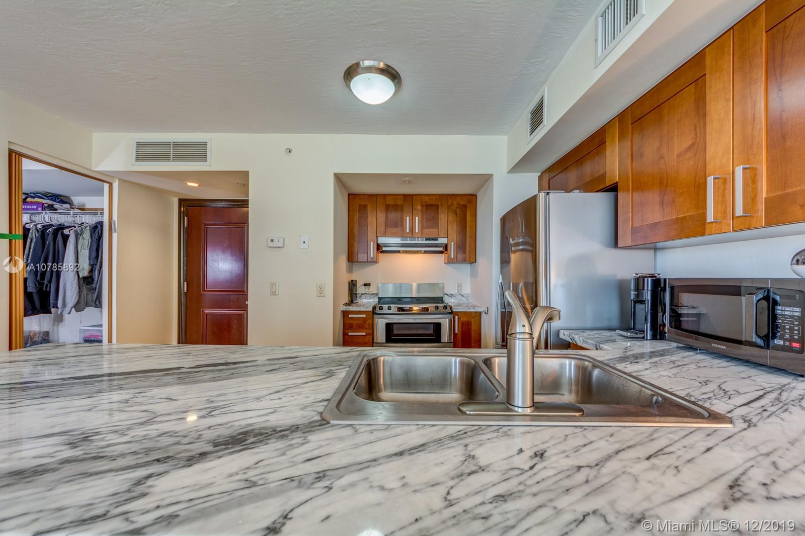 Very rare CORNER residence- only a few unit offer 2 BALCONIES. Beautiful SW Exposure. Spacious open concept & modern 1 bedroom + den (can be used as 2nd bedroom) washer & dryer in the condo. Large master suite & closet - Breathtaking views of intracoastal, Ocean and spectacular sunsets! Ocean front Boutique style building offers full service, valet, management on site, beach service, fitness center. The Spiaggia is located in the heart of Surfside, steps from great shopping & dinning on Harding District and Bal Harbour Shops ,Surfside Community Center- walking distance to house of worship & in same block to Grand Beach Hotel. Special Assessment paid in  FULL by seller !! Tenant until November 2021 (paid the full year )$2,300 PM . Du to Covid :Can been shown only with offer to purchase .