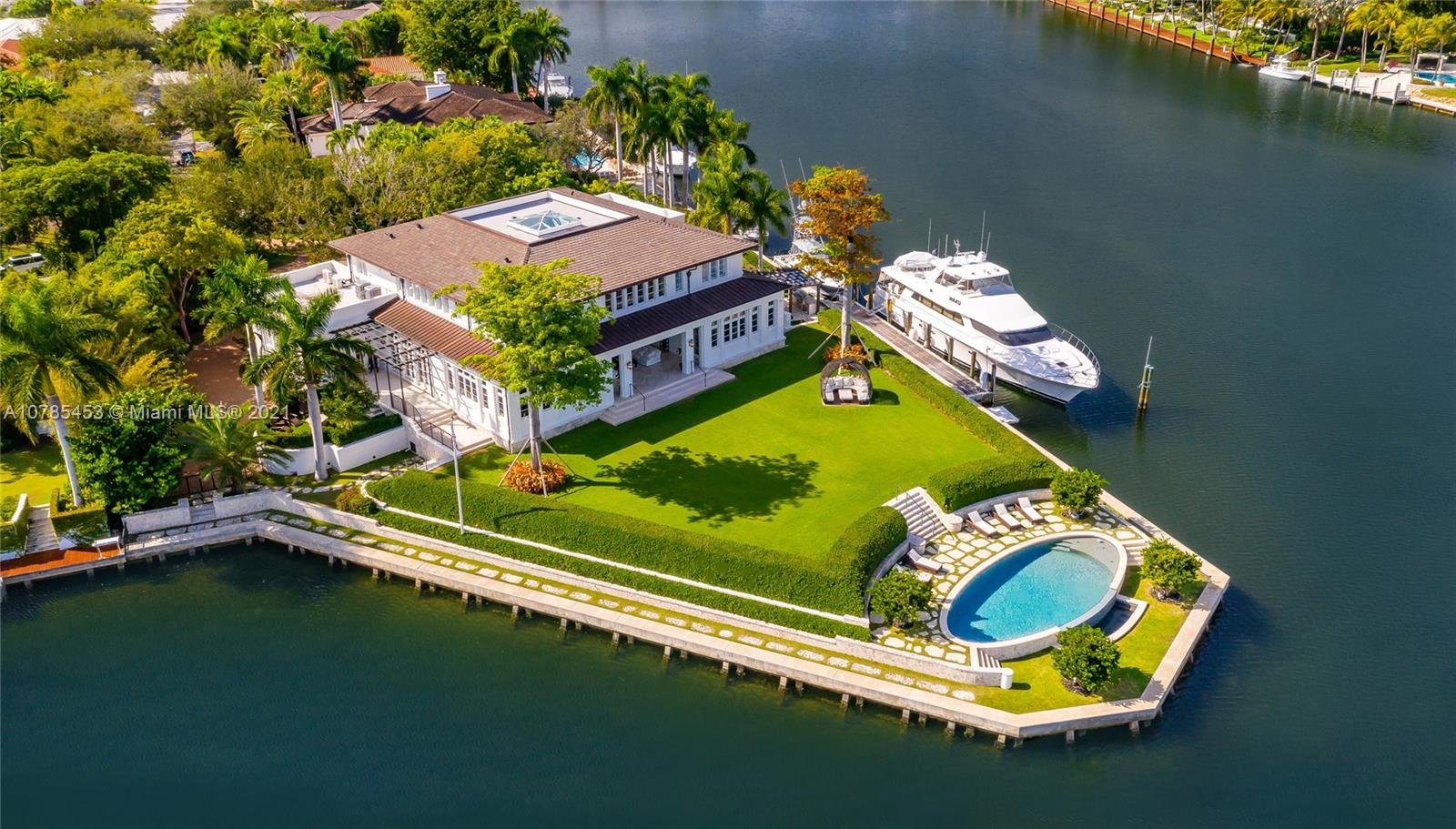 Custom estate built in 2016 in the exclusive gated Old Cutler Bay sitting on a rare 1acre peninsula lot with 435ft of waterfront & a 75ft dock.This completely smart home w surround sound throughout offers 19,390SF Total with 7B, 7.2b with master bedroom on the main level. 1st floor also features formal & informal living spaces,formal dinning room,breakfast area, chefs kitchen w/ 3 Subzero fridge/ freezers, bar area, temp.controlled wine cellar, library/media room and office. Take elevator or stairs to the 2nd floor that features 4 guest suites, hobby room, 2 staff rooms,laundry room,& upstairs family room. The stunning backyard features a resort style pool/jacuzzi, fire pit,full outdoor kitchen,& cabana bath.Home also features an 18 car garage,storage rooms,generator & captains quarters.