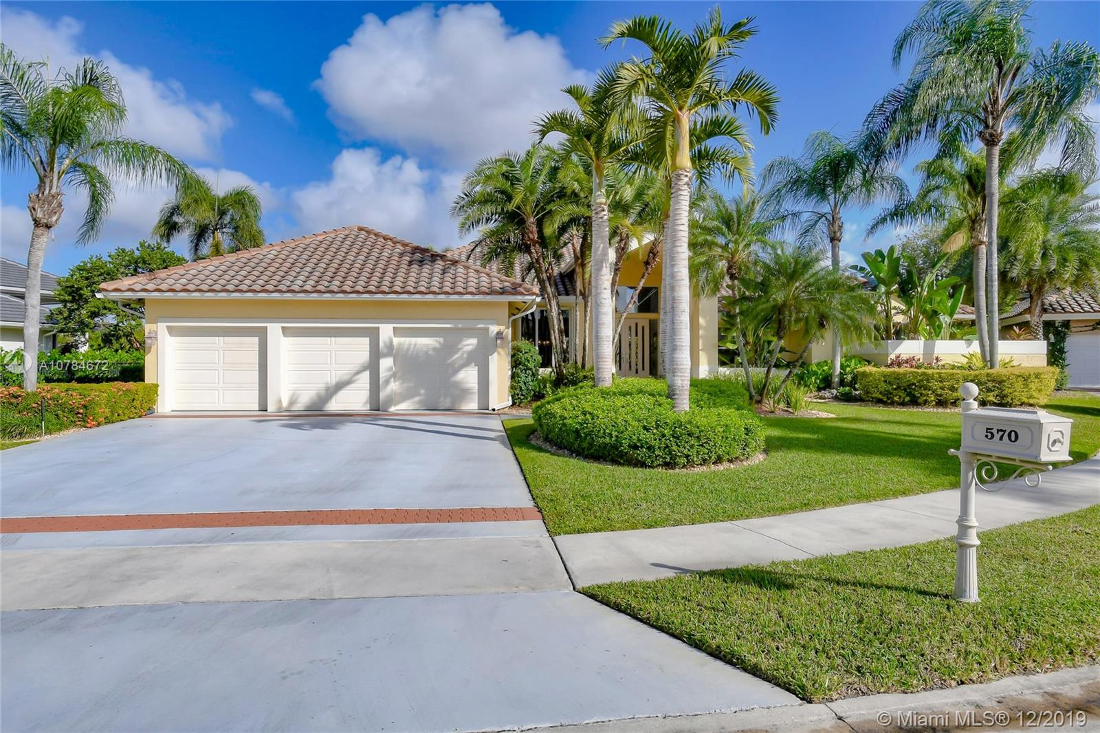 Tucked on a quiet Royal Palm tree lined cul de sac street with lush mature landscaping and endless lake views. Walking distance to Elementary and middle school. Oversized 17,646 sqft lot. Meticulously maintained, this custom one story shows light and bright. Feel the breeze as you sit on your private covered patio, overlooking vertical pool with peaceful lake views. Fully fenced and lushly landscaped. Renovated kitchen with wood cabinetry, granite countertops and Stainless Steel appliances. Full function bar. Great spacious house for entertaining family and friends. Master bath with roman tub, granite countertops and large shower. Volume ceilings in living areas and family room. Neutral decor throughout.3 car garage. New Roof 2007 A/C 2010