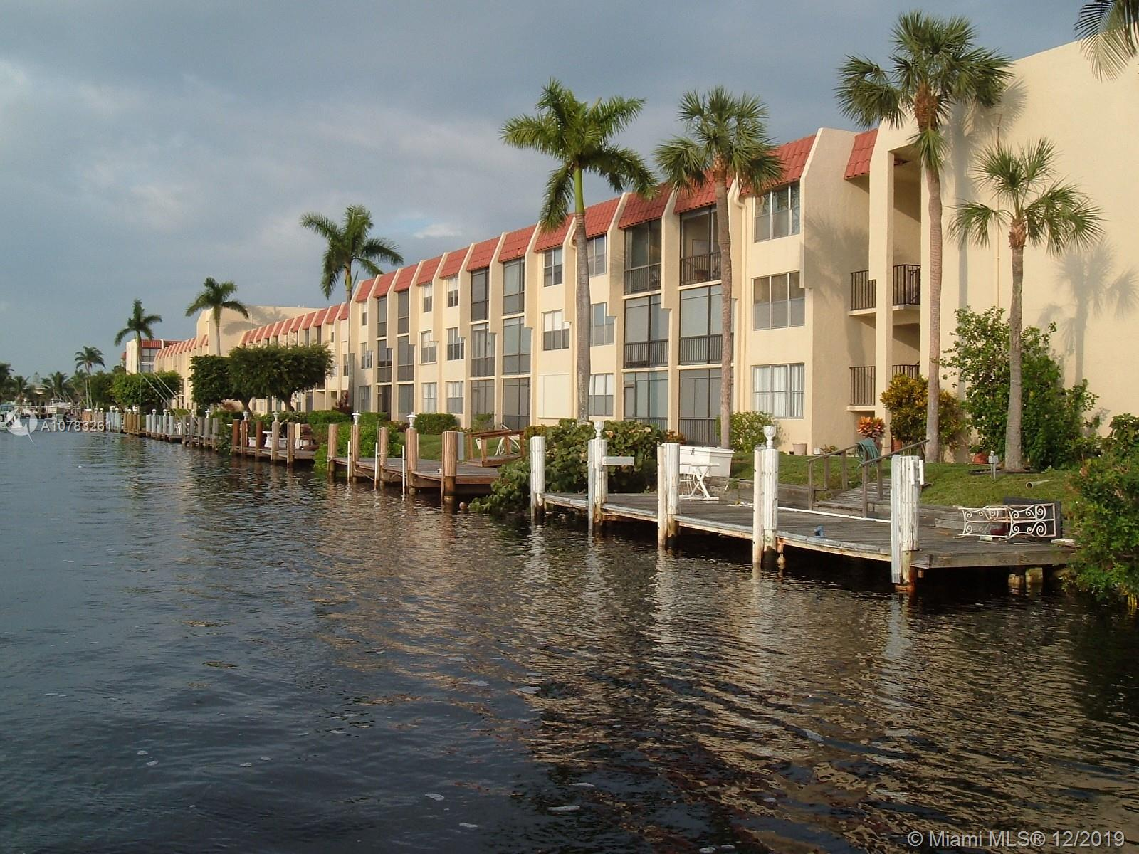 Welcome to the Island Club of Pompano Beach! Watch the constant boat parade pass by. This two bedroom two bathroom furnished condo will be sure to please. Community boasts amenities such as 24 hour manned security, courtesy bus, function hall, billiard room, card room, tiki huts, hot tub, sauna, etc. Complex is close to the newly redesigned  Pompano Beach fishing pier area, dining, beaches, and Greg Norman designed golf course.