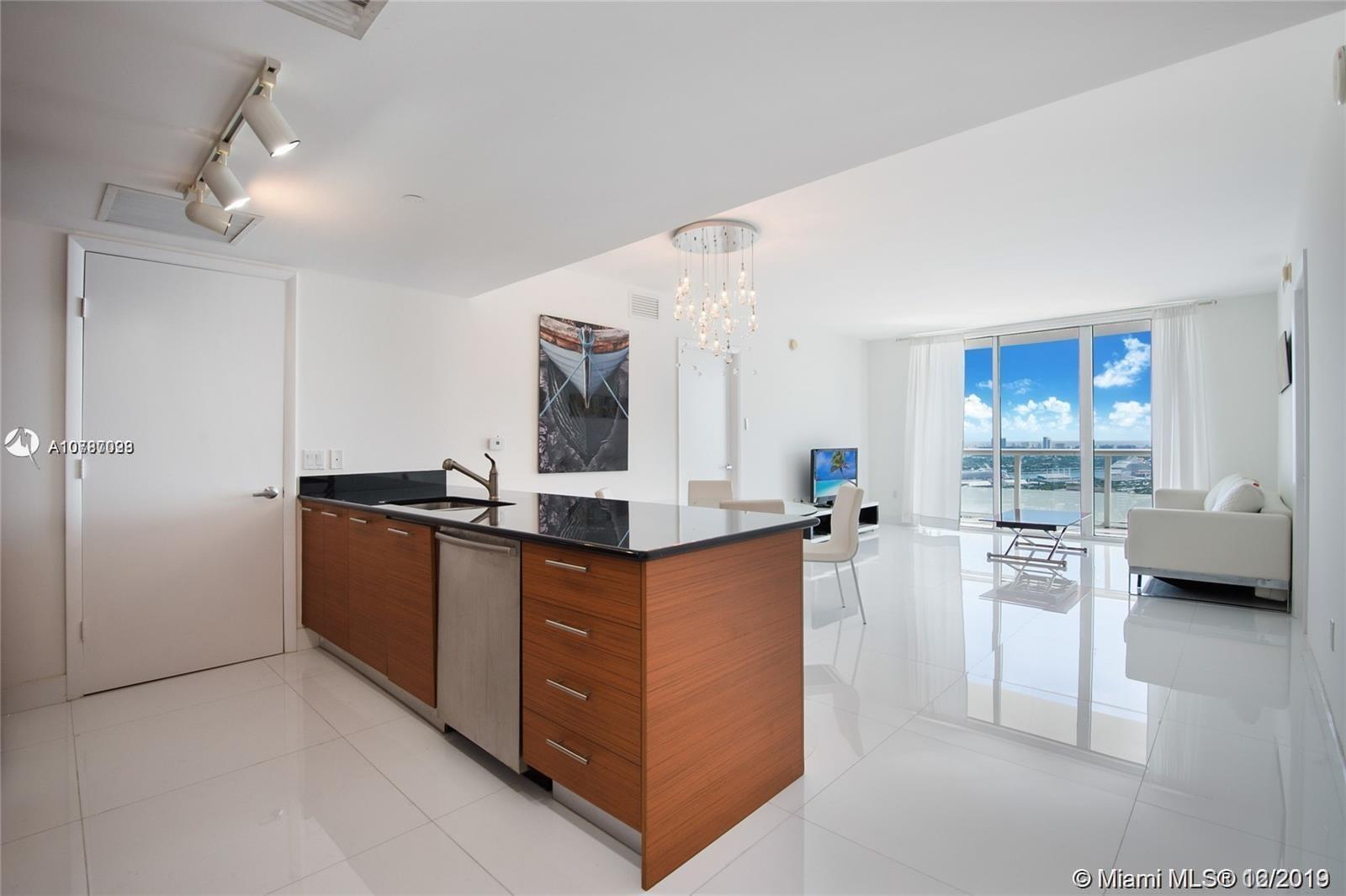 The best views of Miami! Direct ocean and bay views. 2 beds / 2 baths plus Den fully renovated unit. Building amenities include full Gym, Spa, Sauna, Party Room, and relaxing pool area with Olympic sized Heated Pool