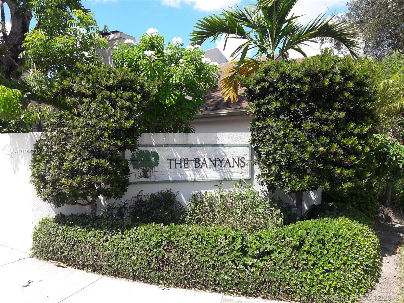 The Banyans of South Miami a private community of townhomes at the intersection of Ludam Rd and Sunset Dr. Spacious 2 story Townhome features ample front and back yard, 3 bedroom and 2.5 bathrooms plus a bonus room as a study or playroom. Spacious kitchen with an enormous island of the kitchen with a formal dining room and fireplace. A screened balcony of the master bedroom on the second floor with 2 more spacious bedrooms. Updated bathrooms and kitchen with all new appliances and fixtures. This townhome is move-in ready. Hardwood flooring throughout the second floor with steps and tile on the first. Newer A/C, Newer Roof, Hurricane Shutters. Community Pool, Tennis Courts. 1 Detached Garage and Dedicated Parking, Guest Parking. Best Location in South Miami minutes to all the City Offers.