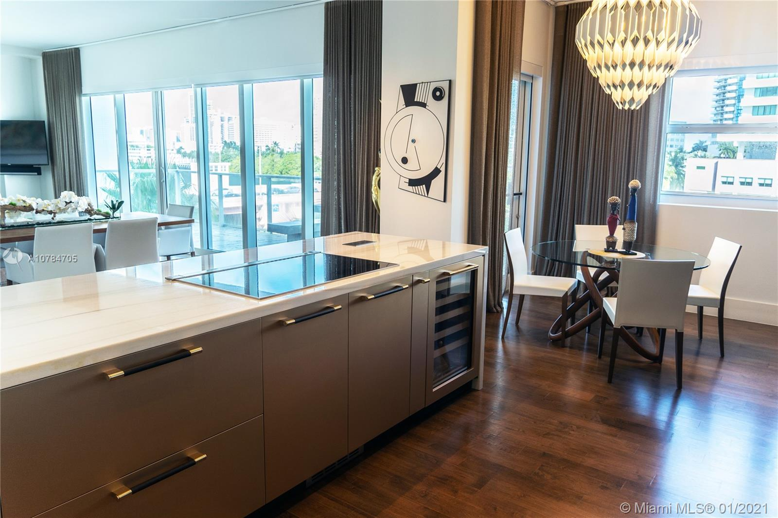 Exceptionally designed with beautifully renovated interiors, this spacious corner 2-bedrooms, 2.5-bathrooms condo embodies prime Allison Island living. The residence features intercostal views and top of the line finishes such as:  brand new Ornare Kitchen with Miele appliances and Thermador downdraft hood, wine cellar, wood floors throughout, Spanish porcelain in master bathroom floors and walls, Built-in Ornare master closet. Smart Centralized system for the lighting, motorized window shades, music and Tv's.  Surround sound and security cameras throughout the apartment.  Amenities include gated private island with two pools, private marina, business center, valet, state of the art gym, concierge and kids room.