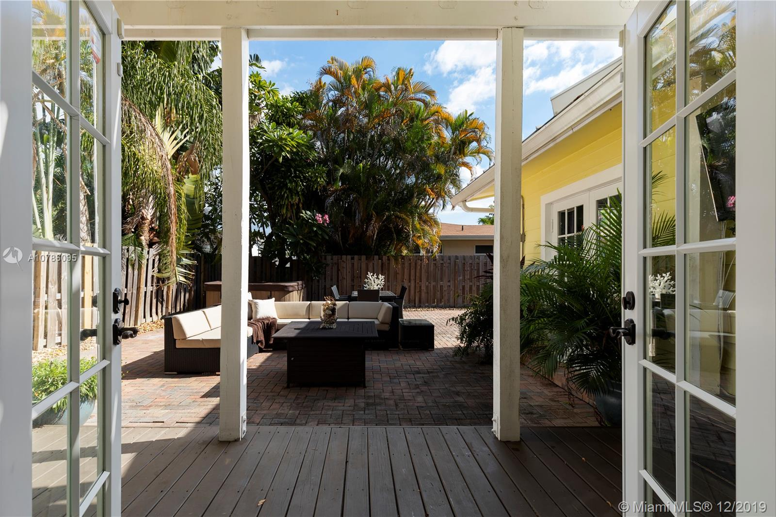 Spacious Key West style home, centrally located in Ft. Lauderdale. Close to shopping, beaches and downtown.  Turnkey home recently renovated.  Private Master suite upstairs with state-of-the-art bath, walk-in closet and private balcony overlooking courtyard and hot tub.  Huge family room perfect for families.  Impact windows and French doors.  RV/Boat Parking