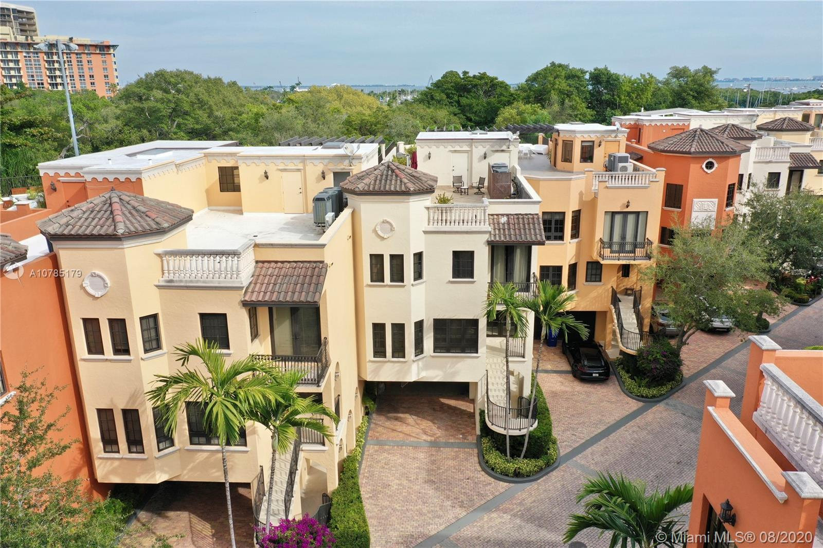 Rare opportunity in Cloisters on the Bay located in the heart of Coconut Grove and within walking distance to local stores, restaurants, and private schools. This oversized  5,650 sq ft unit is move in ready offering 4 bedrooms with en-suite bathrooms, living room, family room, as well as a full den, home office, wet-bar, laundry / utility room, and built closets. This home has 2 entrances, a private elevator, 4-car driveway and 2-car garage equipped with 220 power for electric vehicles. There is also plenty of room for storage throughout. The unit also features an expansive outdoor rooftop area that includes a hot tub and lots of space for outdoor dining and relaxing. The neighborhood itself features a clay tennis court, heated swimming pool, clubhouse, and 24 hour security. Easy to Show!