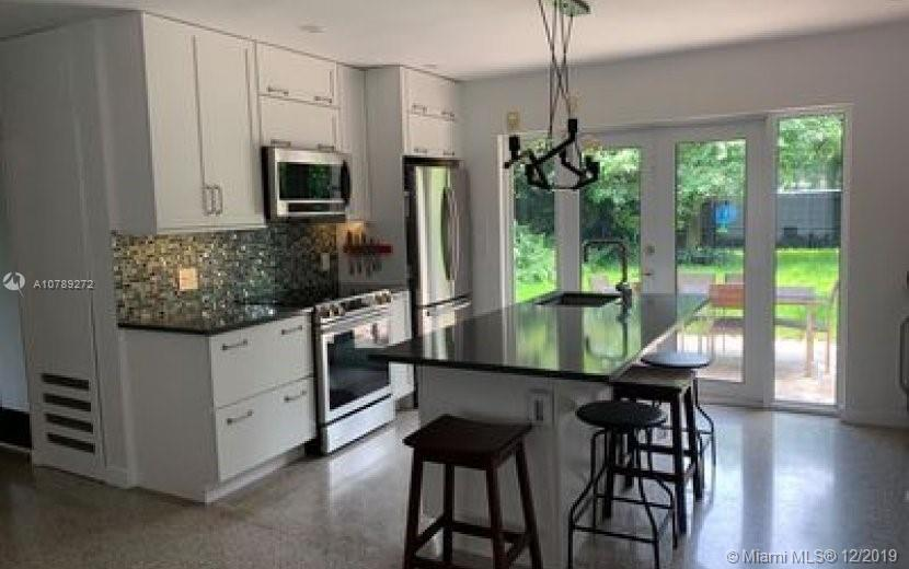 """Newly updated home on a dead end street in the highly sought after Wilton Manors neighborhood. close distance to """"the drive"""" and many other places as well.This 2/1 home has a completely remodeled interior, and lots of upgrades to the exterior too. Hurricane impact glass, new flat roof, with insulation throughout, restored and polished terrazzo floors, built in speakers inside and pre wired for speakers outside. Newer irrigation system with a well that is in full working order and a new tank less water heater.This beauty has an open floor plan and plenty of natural light. This home boasts a chefs Kitchen with high end stainless steel appliances, quartz counter tops and island, a built in 2 tap Kegerator and a built in wine cooler."""