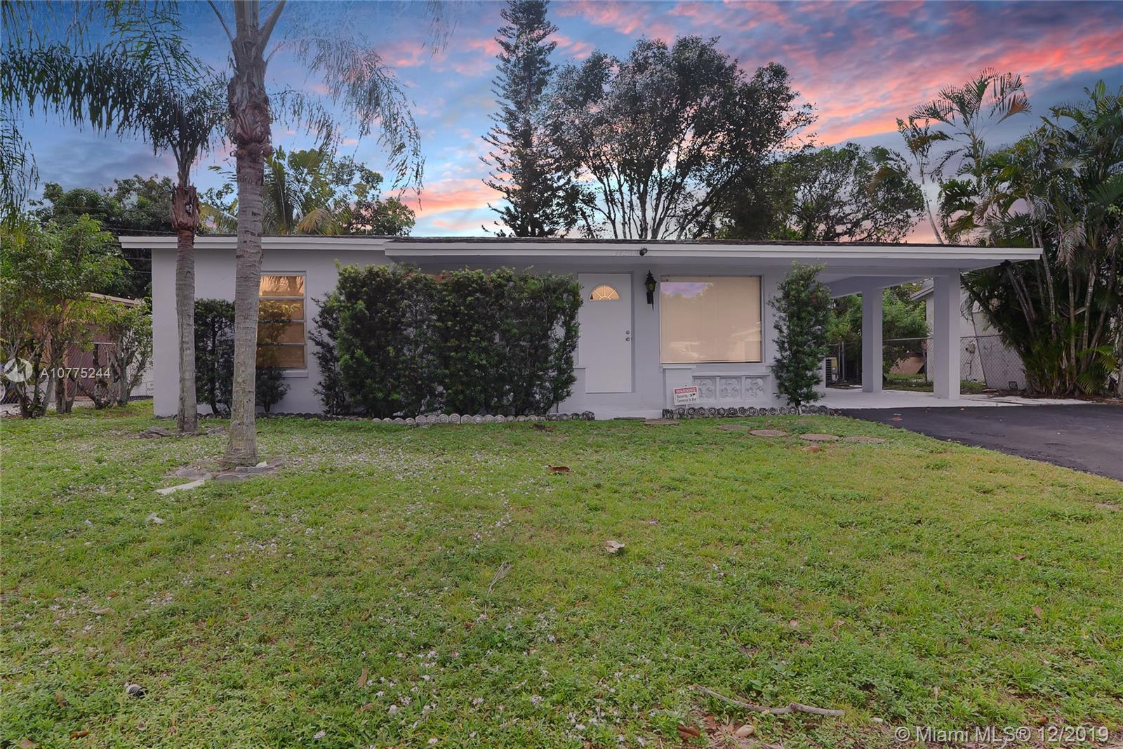 Updated 4 bedroom 2 bath home in the heart of Lauderhill. Property features updated kitchen & baths, stainless steel appliances, tile flooring throughout the home, open layout, covered carport and a huge fenced in backyard! This property makes for a truly great family home! Easy to show.