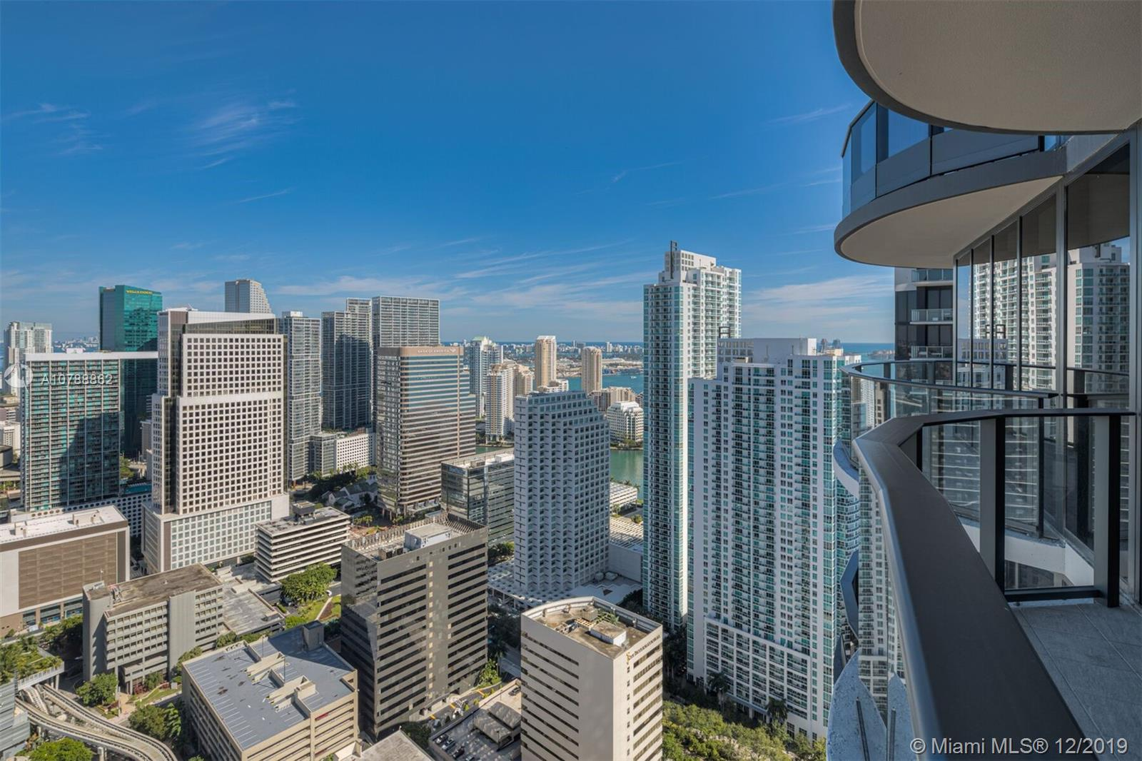 Spectacular brand new  corner unit at the iconic Brickell Flatiron. 2bedrooms / 2.5 baths plus DEN! Top of the line Miele appliances, Nest system thermostat, Italian doors, Glass-enclosed showers,  9-foot ceiling heights, wrap around balcony with amazing views,  Live & play in this luxury building that offers some of the best amenities in the city: Sky club rooftop at the 64th floor offering sky Pool with 360-degree views of Miami & Biscayne Bay, fitness center with the best views of the city, & Wellness Center & Spa. Flatiron Club at 18th & 17th floors offering a private movie theater, outdoor lap pool, children's playroom, social lounge room, billiards room, & concierge service. EASY TO SHOW. it can come furnished or unfurnished. PRICE RENT FURNISHED IS $7,500 PER MONTH (ANNUAL)