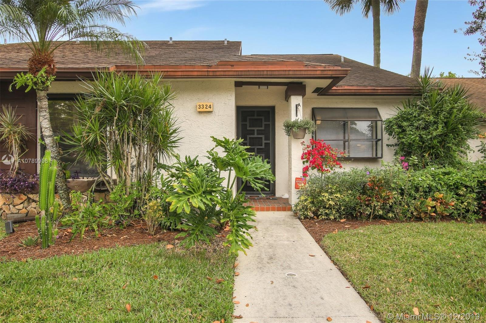 GEORGEOUS, TURN KEY, VERY SPACIOUS UPDATED VILLA IN DESIRABLE TOWNSHIP (GINGER TREE) OF COCONUT CREEK.