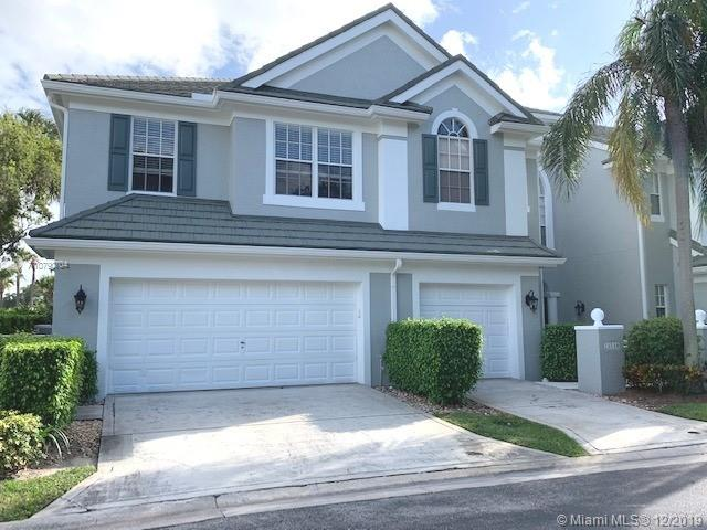 Gorgeous corner unit in Saint Andrews Grand.  Light and bright unit on the canal.  This large 3/2.5 home with 2 car garage has been freshly painted floor to ceiling.  community is gated and central to Boca community, walking distance to Town Center Mall & Shops, minutes to beach, I-95, shopping, restaurants and entertainment.