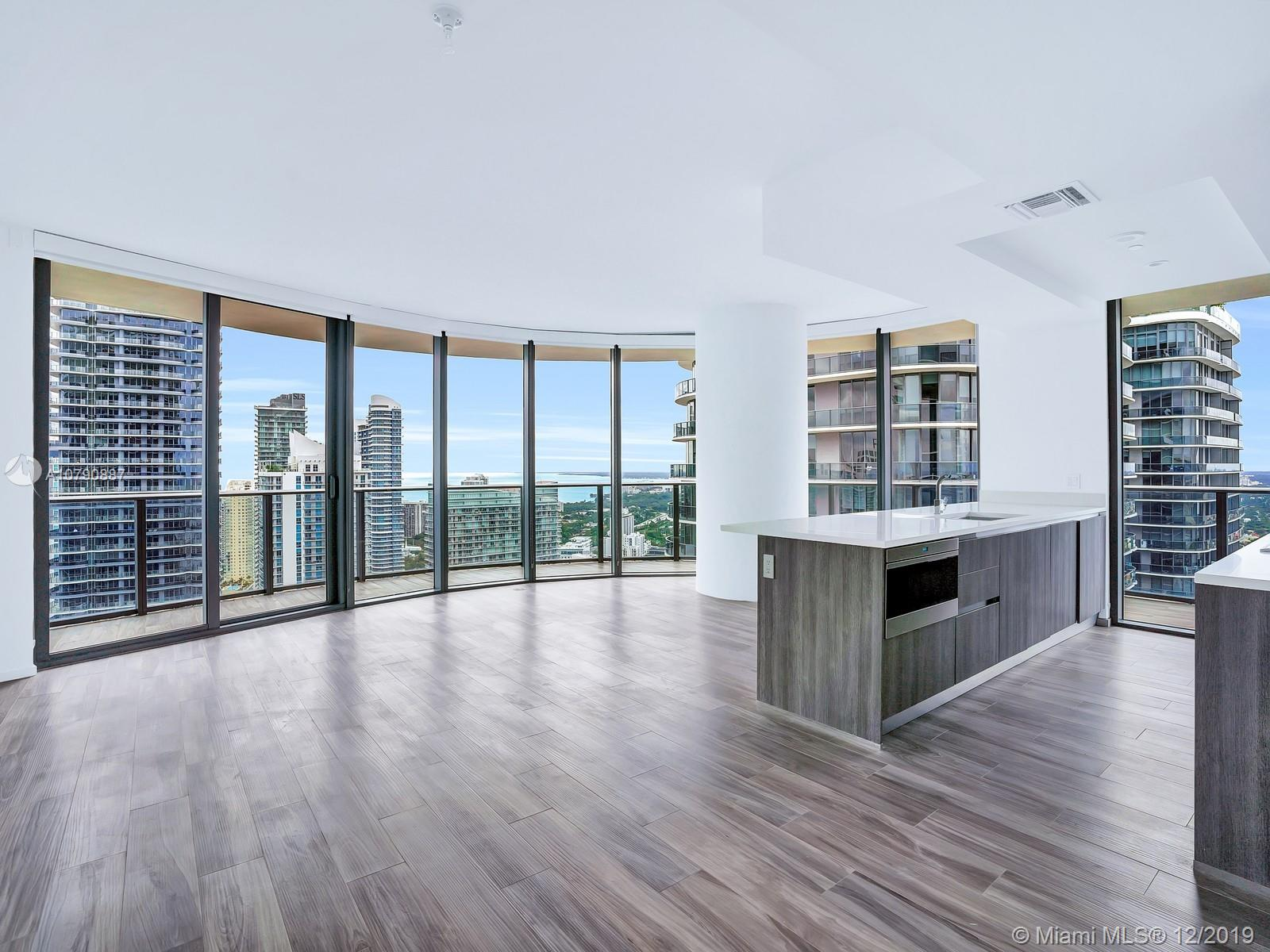 Turn the Key to the largest, most envied kitchen & living room spaced 3 bed/ 4 bath + den layout offering 1,774sf in SLS Lux! Boasting wraparound floor-to-ceiling windows accompanied by an extended balcony overlooking Biscayne Bay & the Brickell skyline. Each spacious bedroom features a relaxing en-suite bathroom and offers plenty of closet and storage space. The walkability & prime location offers a desirable live, work & play lifestyle. Enjoy concierge & room service from a building-linked iPad.
