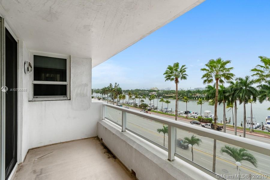 Completely remodeled, large 2/2 in oceanfront building recently updated with impact windows throughout.This unit has the unique combination of being elegant and livable at the same time. Tastefully renovated in white and grey, open kitchen, open floor plan - this unit comes with a full size washer/dryer and a BONUS room.  The living room can be divided with and accordian door to create private third sleeping space. Tranquil view of Indian Creek.  Assessment paid in full on this unit! This is a MUST SEE!!