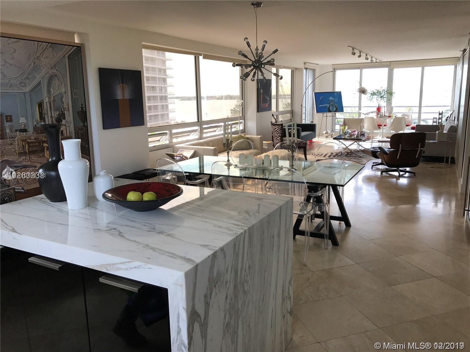 Beautiful corner unit of 3 bedrooms and 2 bath, 2000 sf of A/C. ( both balconies were added to the apartment during remodeling)  Amazing wide open bay views on one side and city skyline Brickell Ave views on the other side. Italian kitchen, calacatta marble kitchen island, top of the line viking appliances. One of the few 3 bedrooms unit in the building and a corner unit with no neighbors walls