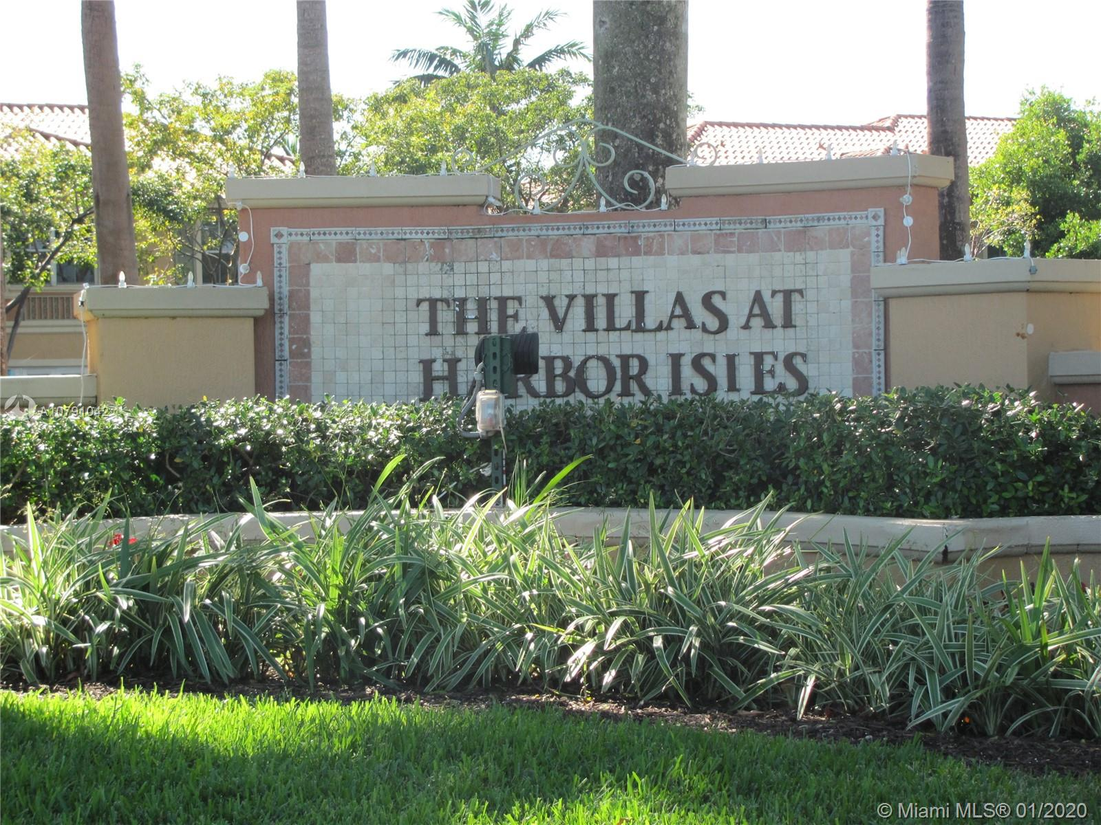 Beautifully kept 3 bedroom, 3 FULL bath townhome in the Villas at Harbor Isles.  Gorgeous lake view, electronic gated entrance.  Excellent location, a few minutes from beach, Tri-rail, I-95 and 595. Minutes to Fort Lauderdale or Miami. Features two child's playground areas, workout area, pool and sauna area, indoor dramatic ceiling heights, full-size washer and dryer, large walk-in closets, custom-crafted European style vanities. This is a must-see!