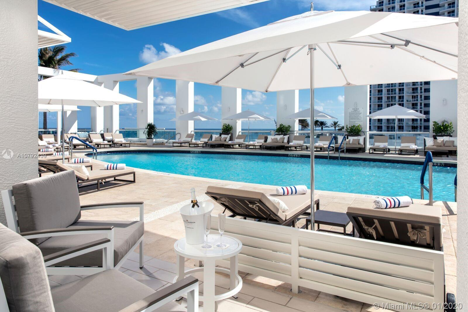 Luxurious Resort Residences, presented as hotel/condos, professionally designed & fully furnished by Steven G. This unit features ocean and intracoastal views, marble bathrooms with double sinks, marble tub & separate walk in shower. Kitchen has a Wolf range and Subzero appliances. Luxury resort amenities, including twice per day housekeeping, laundry service, beach service, pool service, gym, house car service, Conrad spa, 24 hr valet parking and more. Hilton Gold Membership. New Construction, now open, close immediately.
