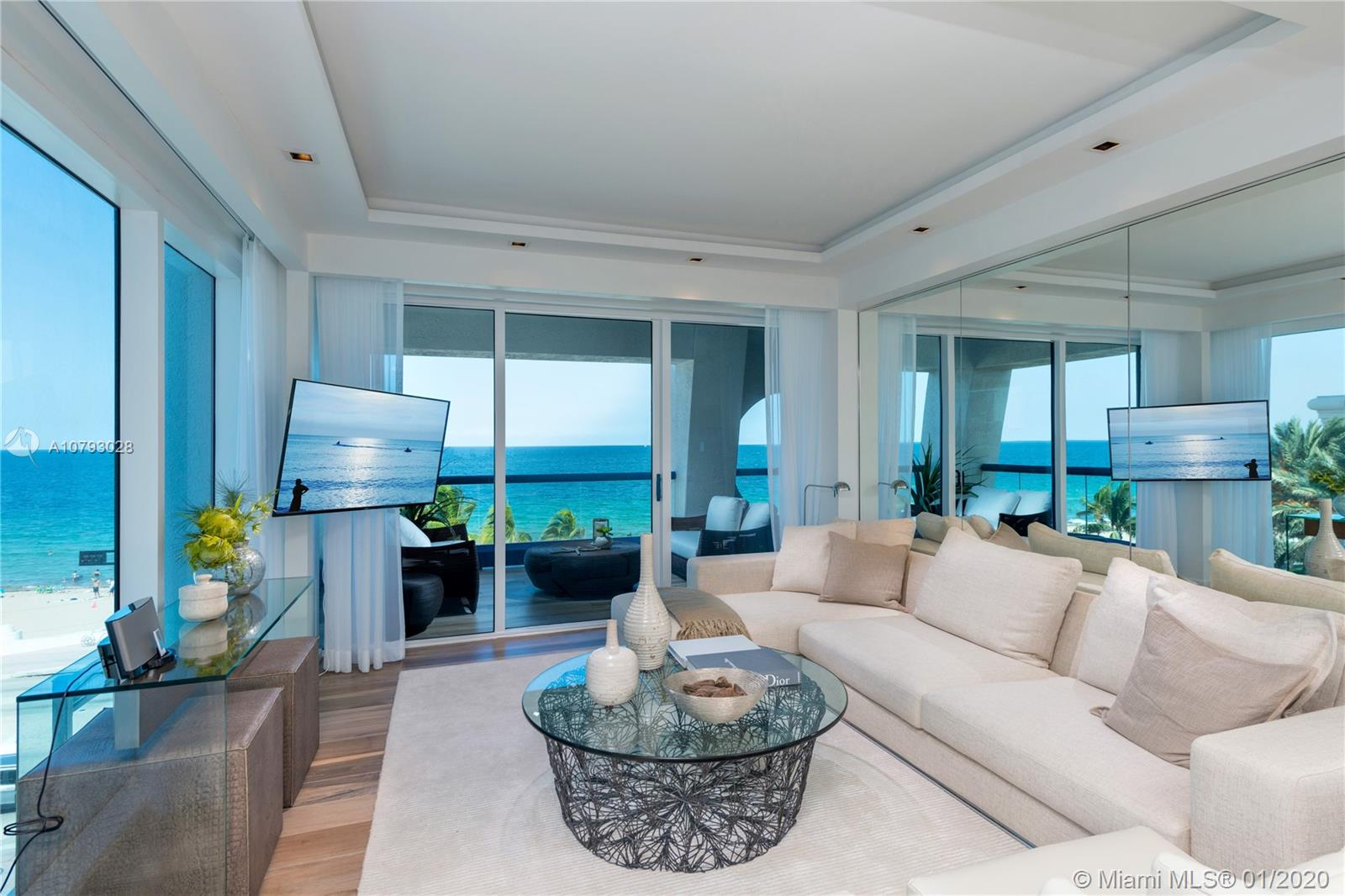 Watch the waves crash from this one of a kind, Beachfront Villa at The Ocean Resort Residences! One of only 20 residences located a stone's throw from the sand. This 2/2 corner unit features Sub Zero & Wolf and Bosch appliances. Beautiful porcelain tile & marble floors finish the unit, with two extra large outdoor terraces. Owners will receive all services & amenities of the Conrad, including laundry service, twice a day cleaning, beach service, car service & Hilton Gold Membership. New Construction, now open, close immediately.