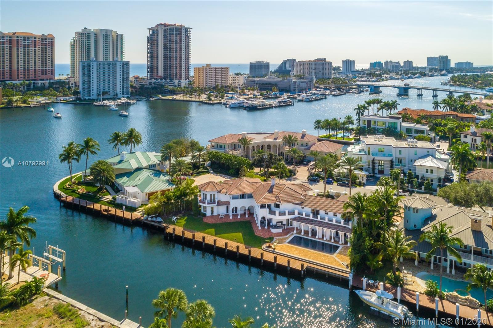 This newly renovated, 9,369sf Mediterranean Estate is located minutes from Las Olas Blvd inside the premier neighborhood of Seven Isles. Offering 6 bedrooms, 7.5 bathrooms, a separate guesthouse, gym, movie theater and office - this spectacular lot totals 17,519sf and sits only ONE lot from the open water. A beautifully landscaped and gated driveway offers an elegant grand entrance. Tremendous backyard space, a large heated pool, covered balconies and a yacht lover's dream deck situated upon 185ft of waterfront makes this estate the best deal in the neighborhood!