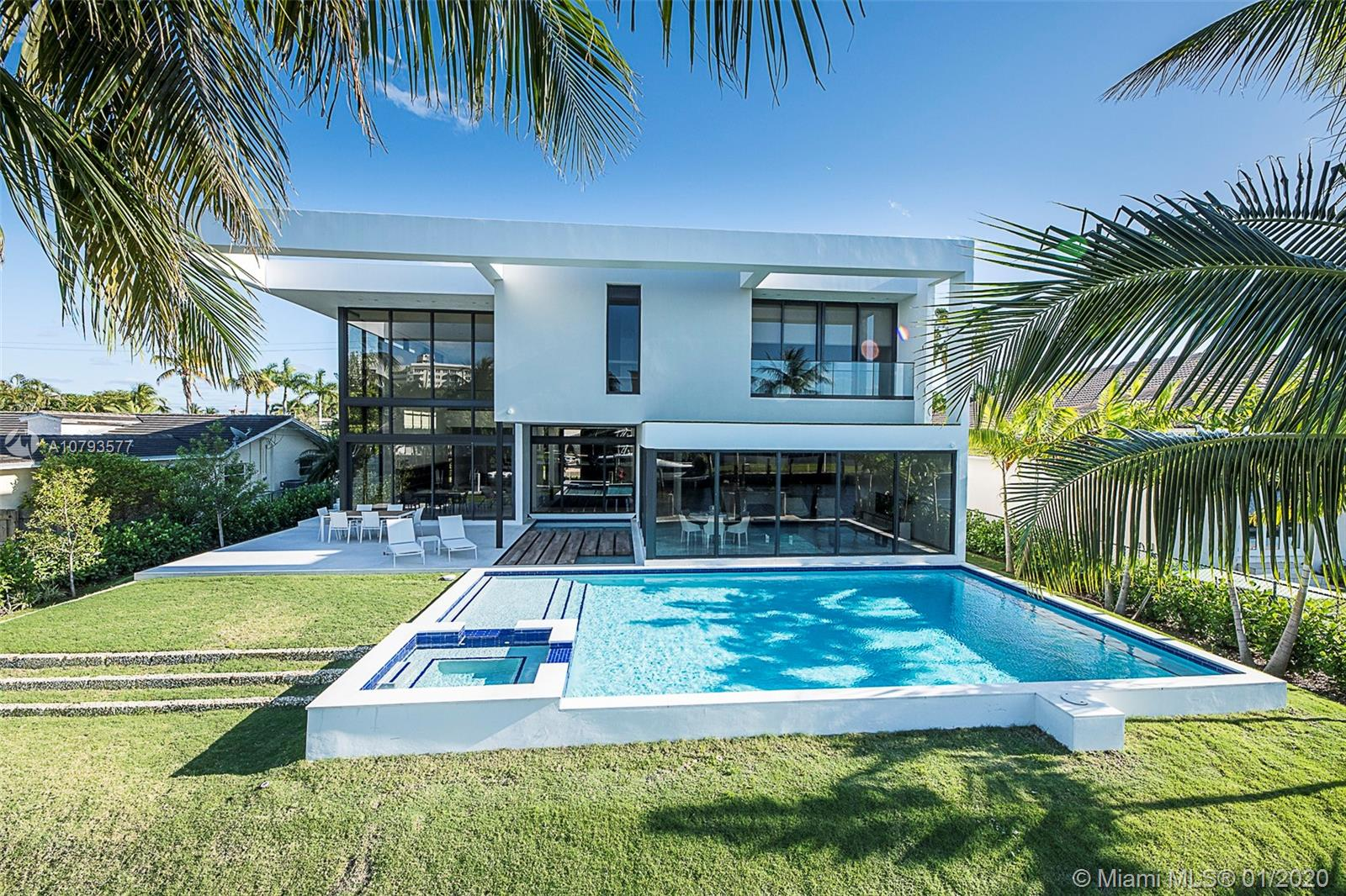 Located on desirable Golden Isles, this exceptionally designed new modern home boasts 6.500 SF of open living space & 85 FT of waterfront. Interior features soaring 24' living room ceilings,6 bedrooms, 6 bathrooms, modern gas kitchen open to the pool with top of the line appliances, 2 dens with the option to make a fitness room or home theater, elevator. Exterior: large pool w/water features & spa, new seawall/dock, & 4-car garage. Interior design by recognized BBH Design Studio. You will fall in LOVE!
