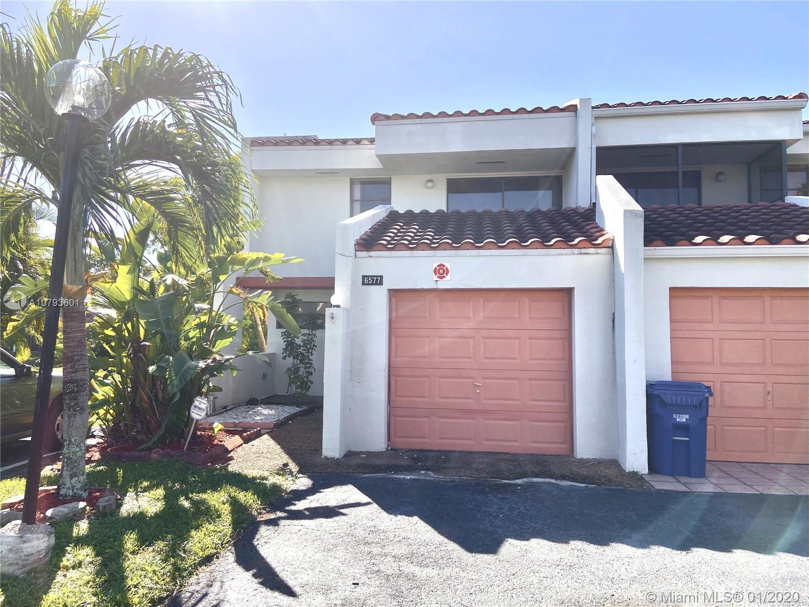 Spacious remodeled and freshly painted Corner unit Townhouse! 3 bedrooms 2.5 bathrooms! Huge walk in closet in Master bedroom and private balcony overlooking tranquil waterviews. Ceramic tile throughout the living areas, kitchen and all the bedrooms.  Brand new water efficient toilets and faucets in all the bathrooms.  Private laundry room.  Garage and extra parking spaces in front of the townhouse! Gated community features clubhouse, pool, exercise room, and management on site!