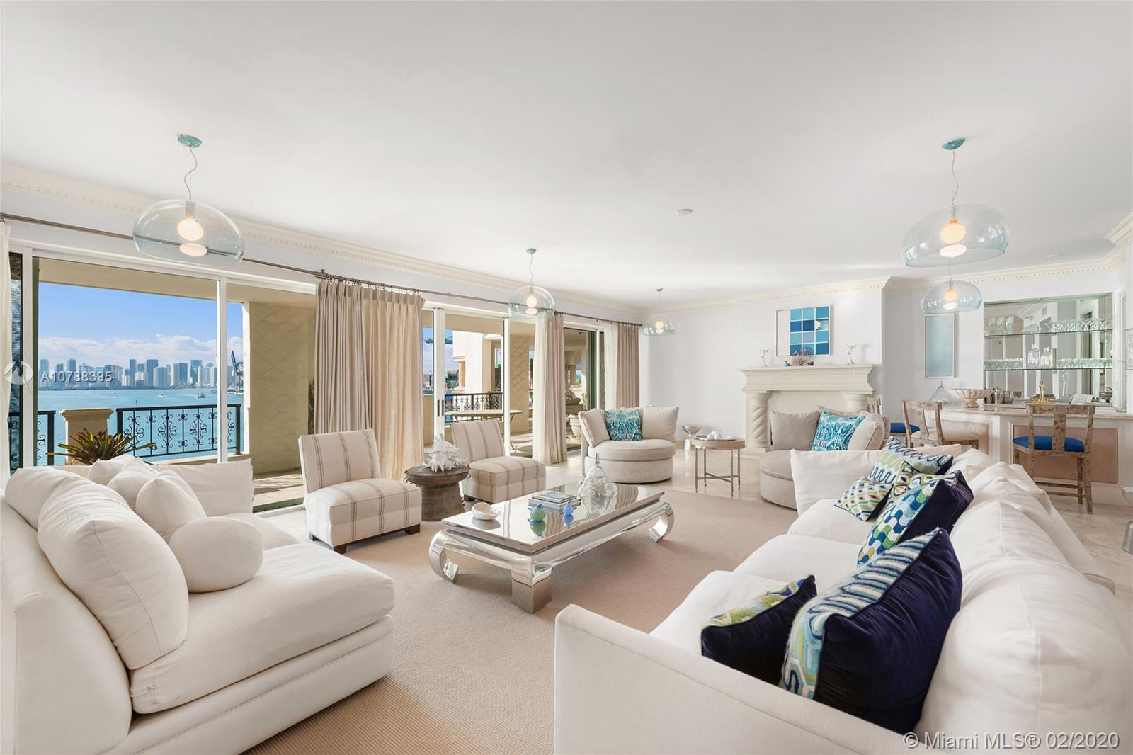 This beautiful Bayview unit on Fisher Island features 5,790 SQFT of interior space & 2 large private terraces w/unobstructed views over Fisher Island, Government Cut, the Atlantic Ocean, Biscayne Bay and the downtown Miami skyline. The spacious open living room and private dining room each have beautiful fireplaces & amazing views to the bay & Miami skyline. A large open kitchen sports top appliances, center Island with eat-in seating, butler's pantry & an adjacent family/media room made to relax & entertain. The principal bayside suite has a fireplace & large bathroom with glass marble shower, sunken spa tub & voluminous walk-in closets. The other 4 bedrooms are well proportioned. 5-star Fisher Island amenities complete this offering.