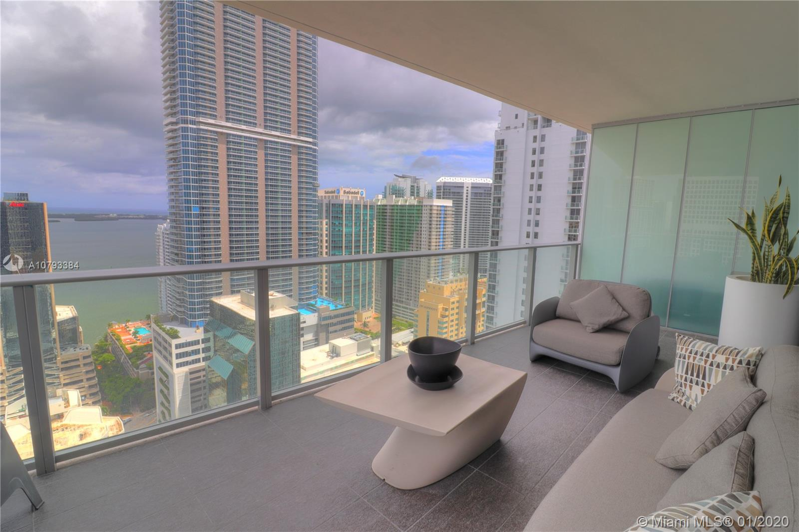 Incredible corner unit at 1010 Brickell Condo, best line in the building overlooking the bay. Private elevator with 3 beds, 3 baths, + den 9-foot ceiling heights, balcony with barbecue/ summer kitchen. Marble floors , Top of the line Smeg appliances! 2 Parking Space included and storage unit. Great amenities for families; outdoor movie theatre, restaurant & swimming pool at 50th floor roof top; spa with jacuzzi, message & treatments rooms, sauna & steam room; basketball, mini soccer & racquetball courts, kids indoor playground, indoor heated swimming pool, fitness center, party room, arcade room with bowling virtual golf, and more!.